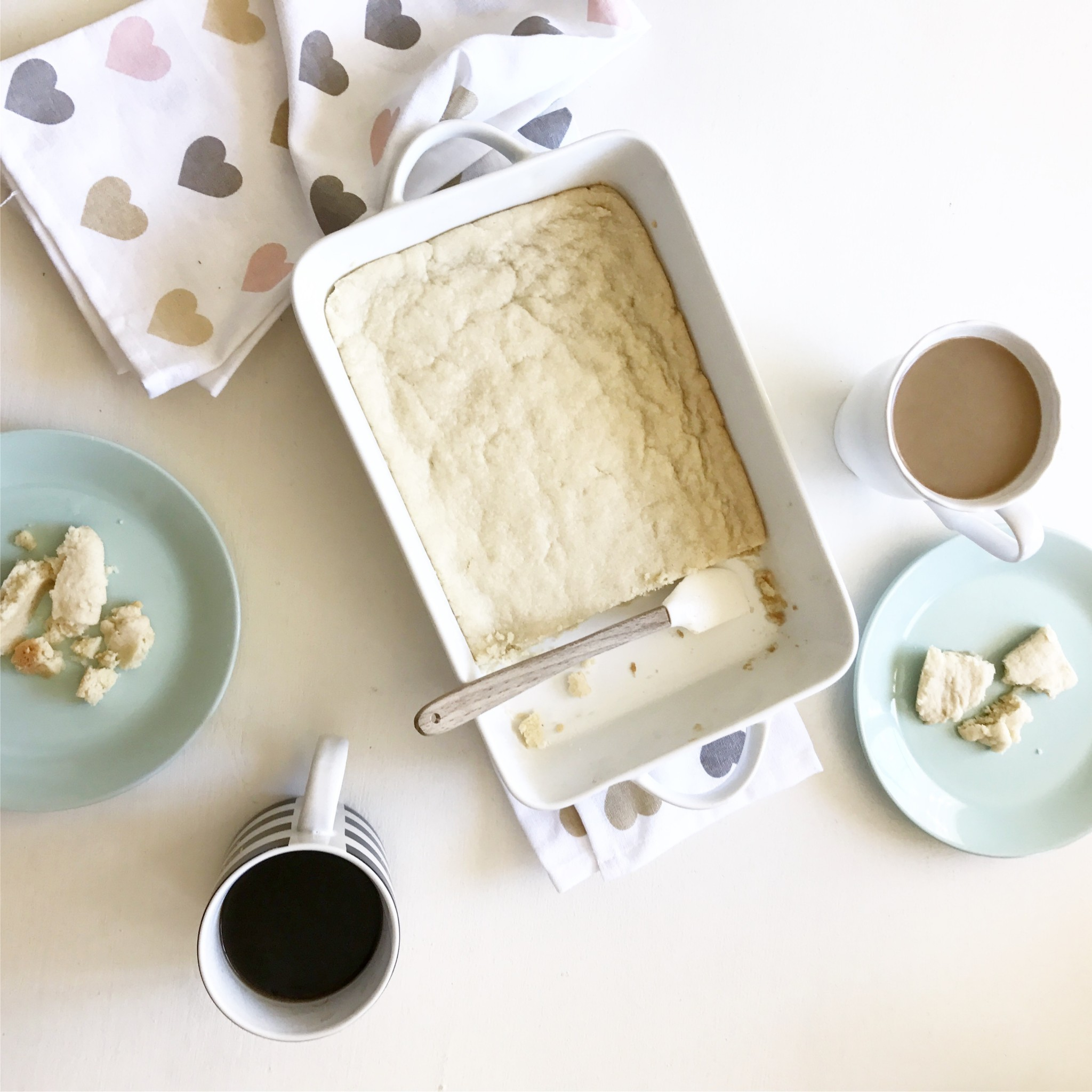 Homemade shortbread recipe in a white dish with coffee