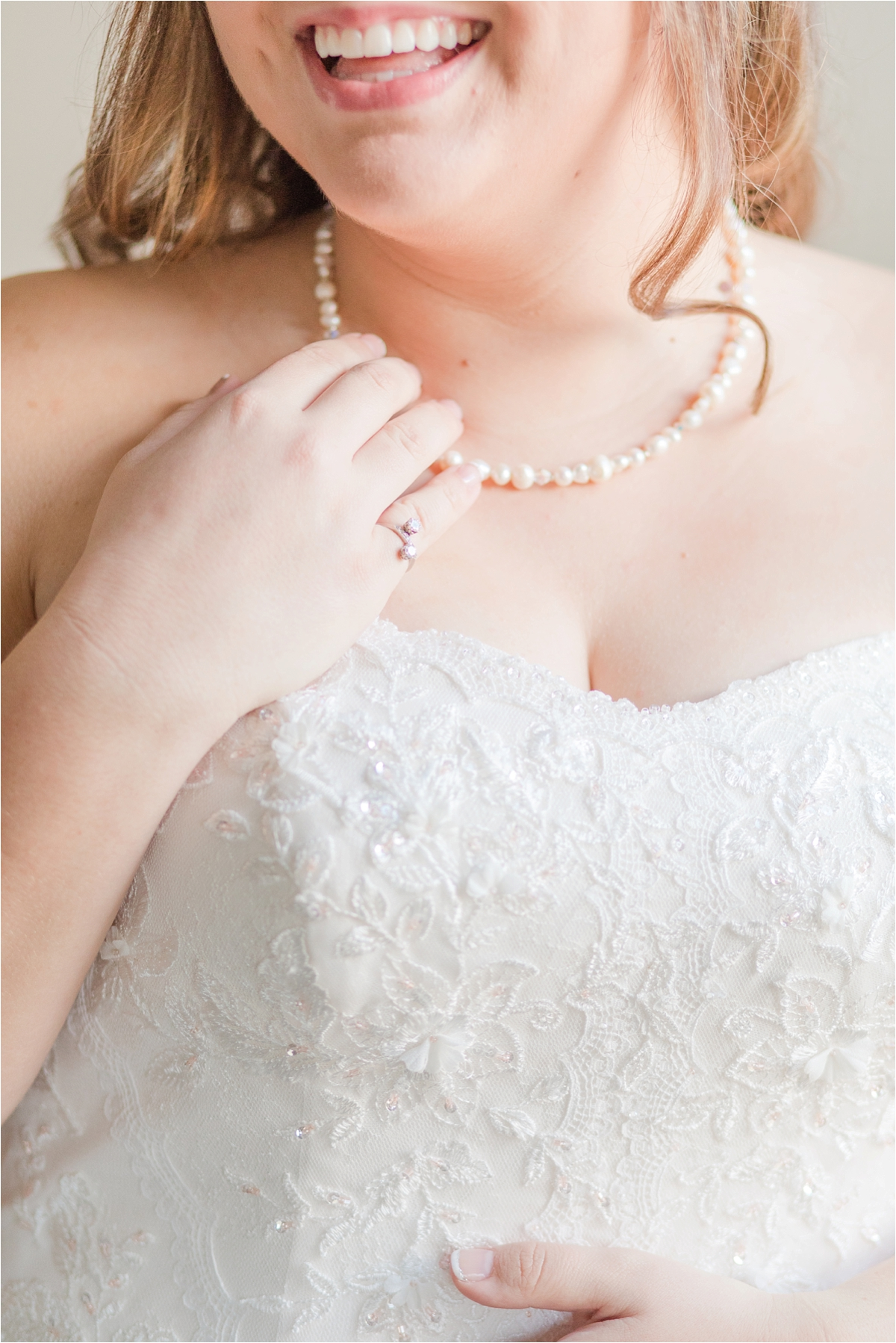 bridal-portraits-photos-bride-alabama-wedding-photographer-putting-jewelry