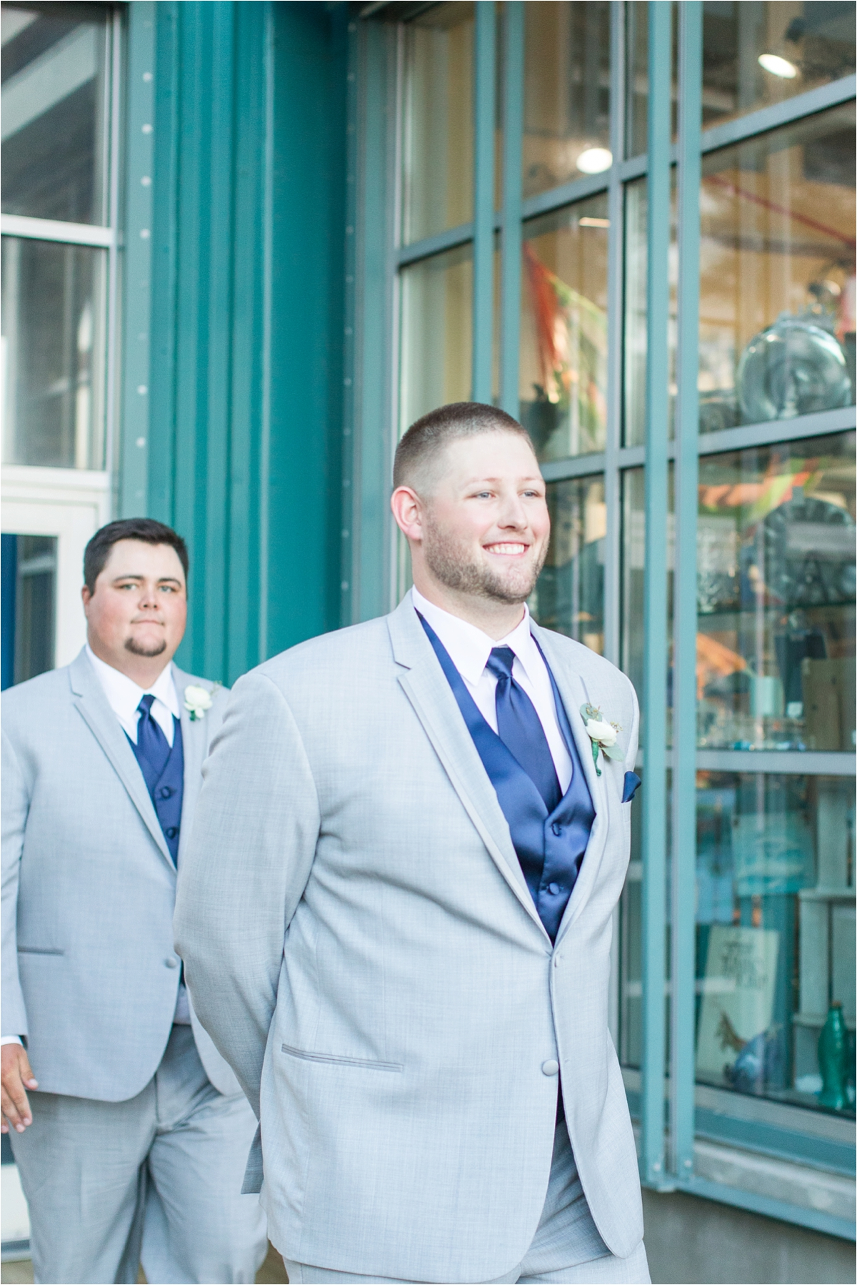 groom-first-look-at the end of the aisle-navy-blue-wedding-vest-tie