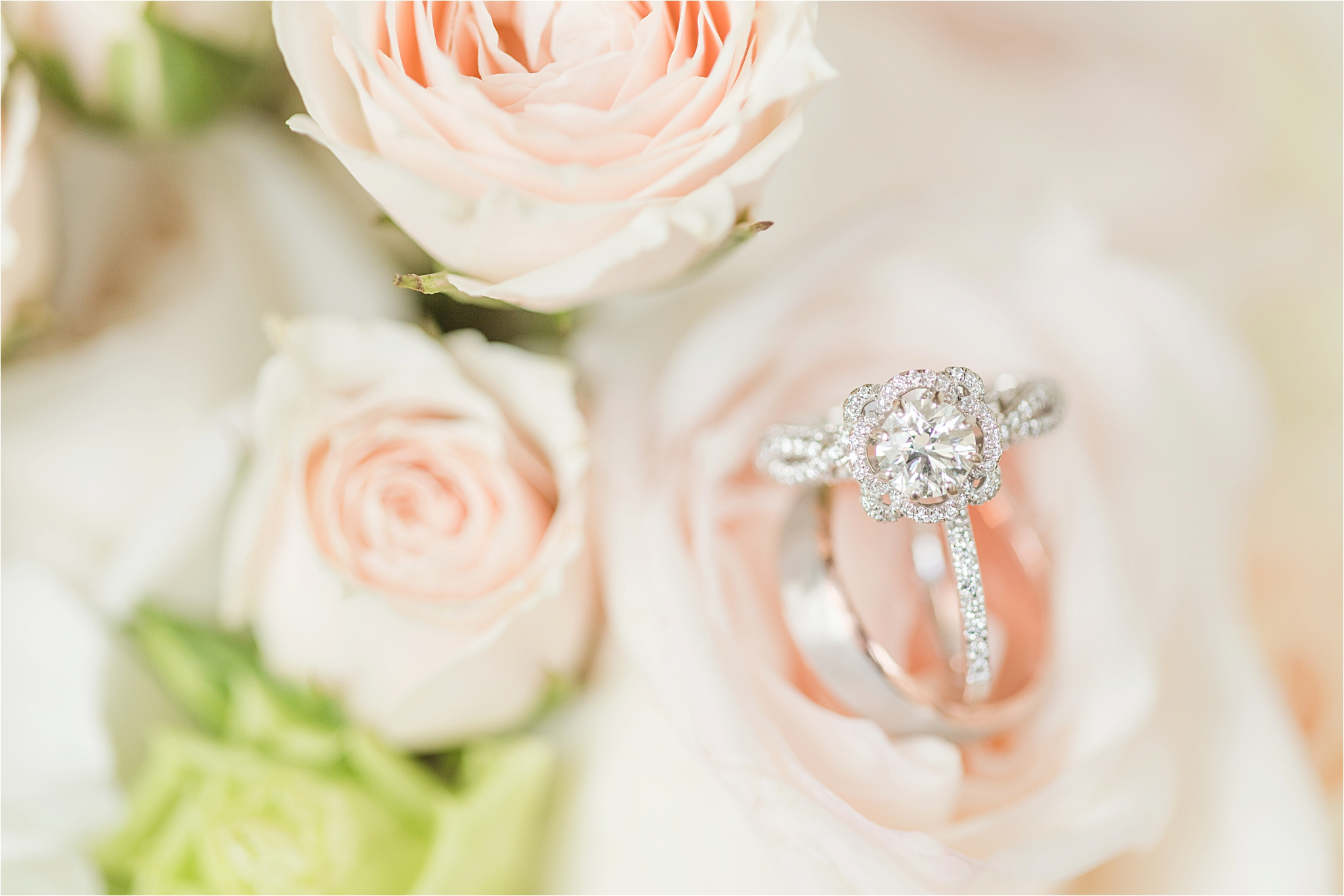 white-gold-engagement-ring-bouquet-twisted-band-round-diamond-cut-blossom