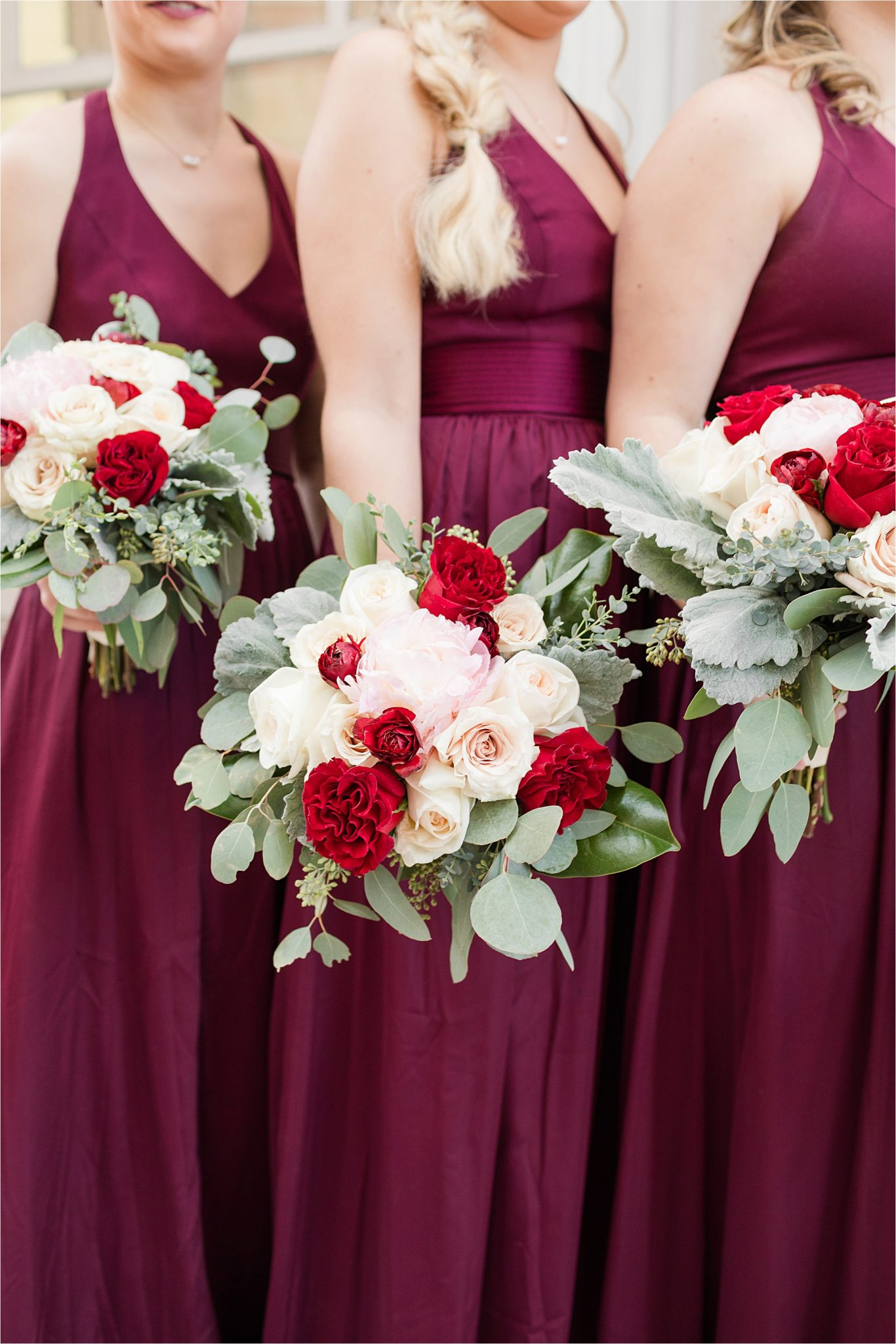 bridesmaids-deep-magenta-plum-dresses-red-white-roses-christmas-wedding-alabama