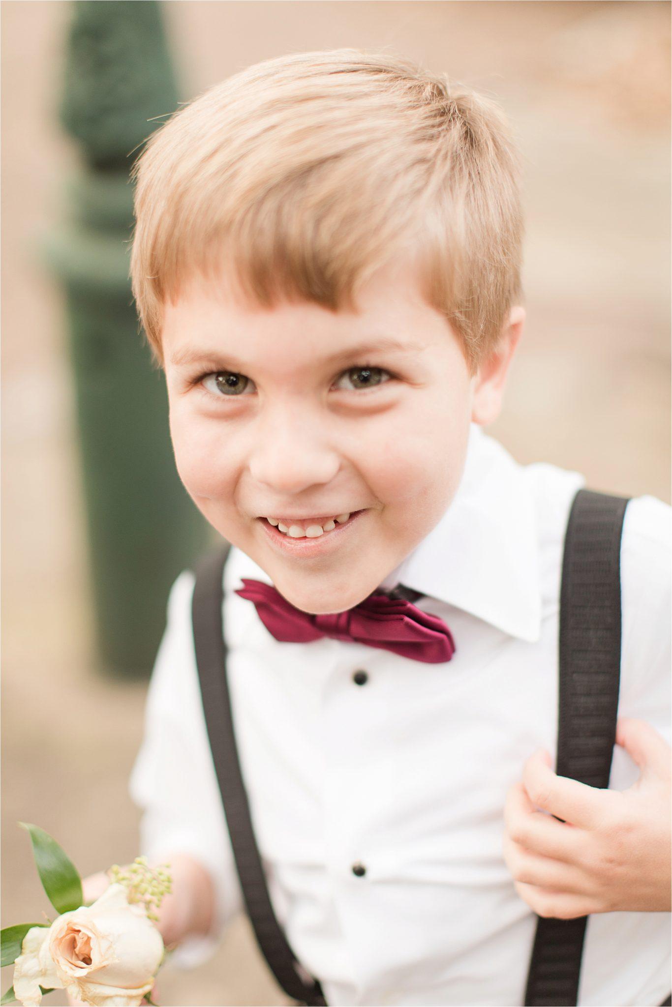 ring-bearer-maroon-bow-tie-suspenders-alabama-wedding-photographer