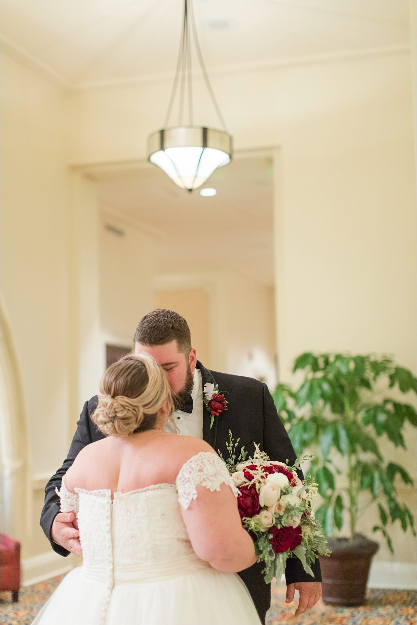 bride-groom-portraits-wedding-photography-Alabama-photographer-mixed-color-rose-bouquet-christmas