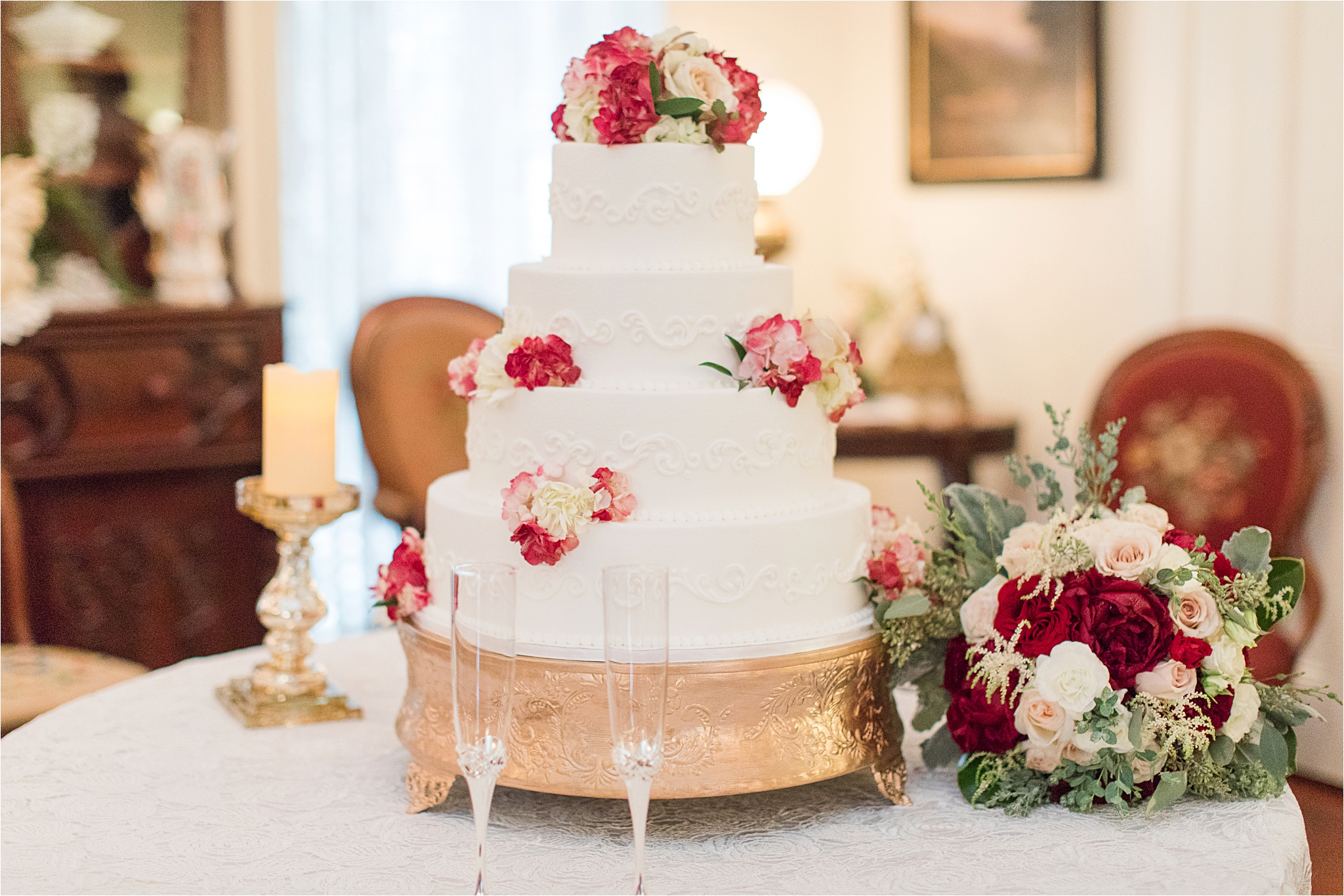 four-tier-wedding-cake-red-roses-bushle-flower-cake-topper