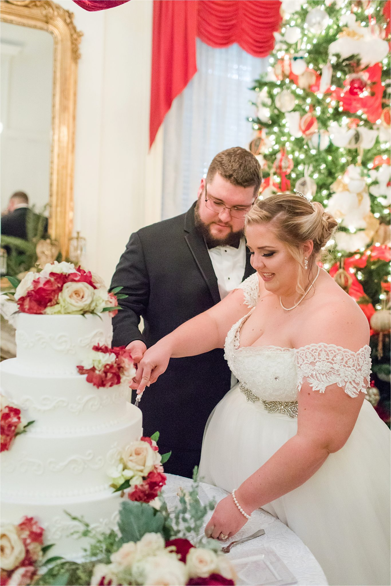 wedding-reception-christmas-winter-cake-cutting-bride and groom