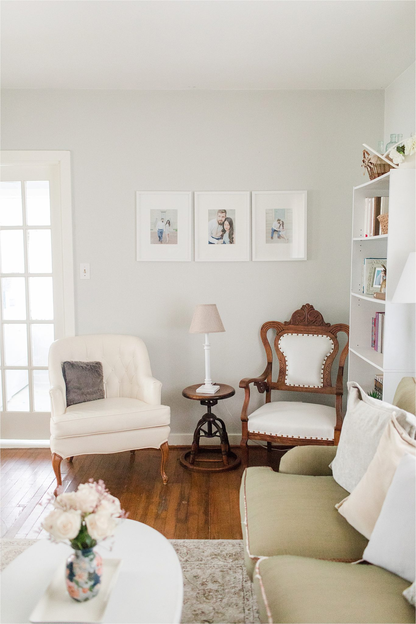 first-home-living-room-vintage-airy-neutrals-family-photos-chair