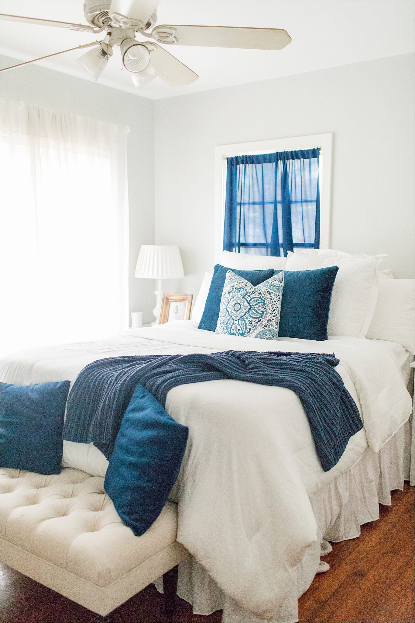 navy blue-accent-color-house to home-on a budget-white-airy-comforter-pillow-design