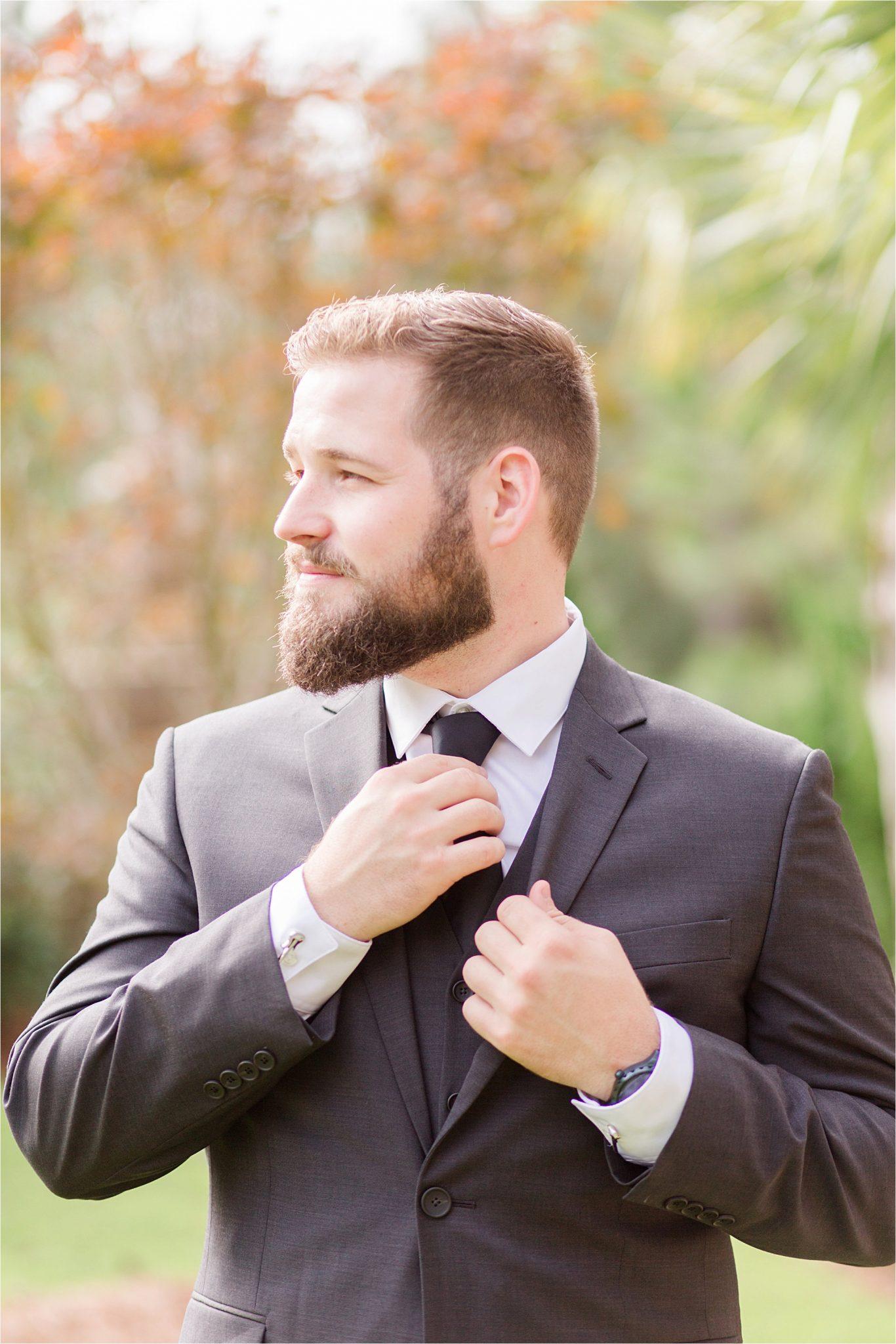 wedding day-groom-black tie-grey suit-beard-strong