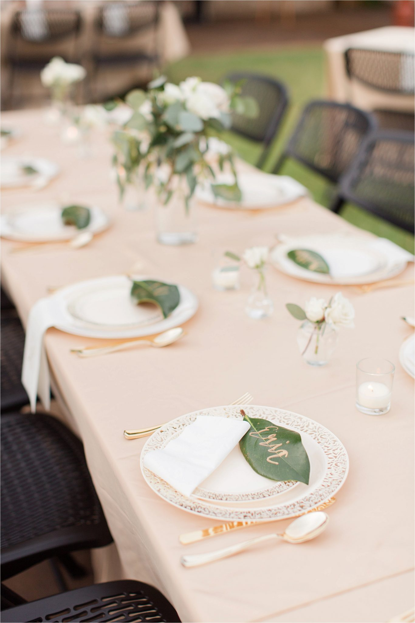 wedding-reception-place-setting-groom-champagne-blushes-nuetrals-white-roses-magnolia-leaves-gold-writing