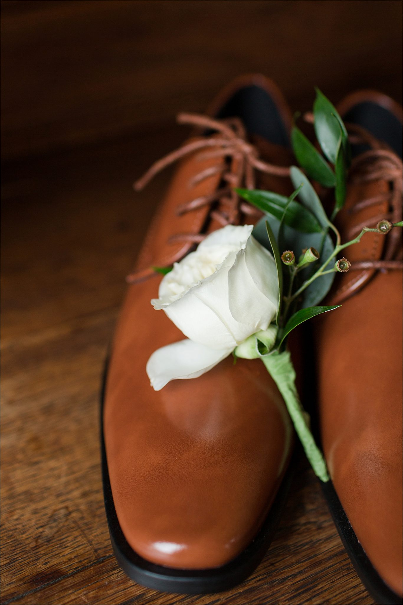 white rose corsage-light brown dress shoes-shiny