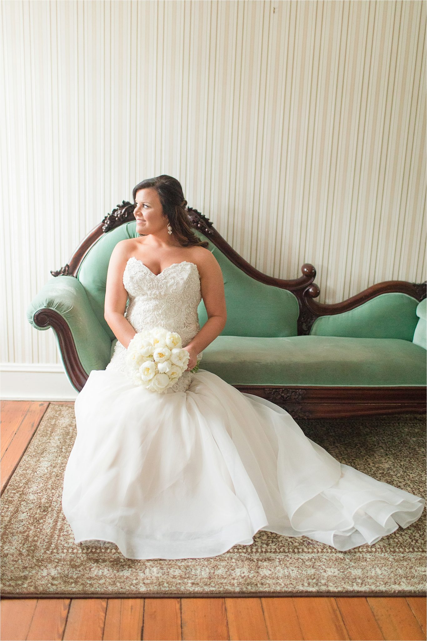 bride on antique couch-antique teal couch-mermaid style wedding dress-strapless