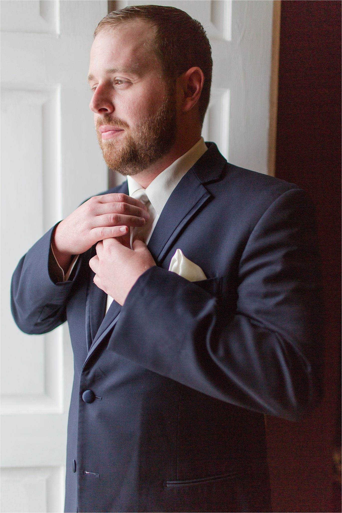 Groom-beard-navy suit-redhead-ivory handkerchief