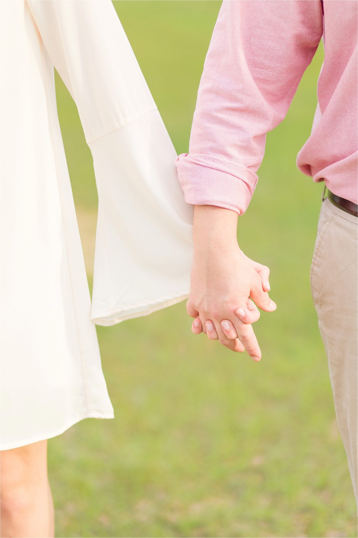 Engagement photos-bride and groom-holding hands-pastels and ivory-Alabama wedding photographer