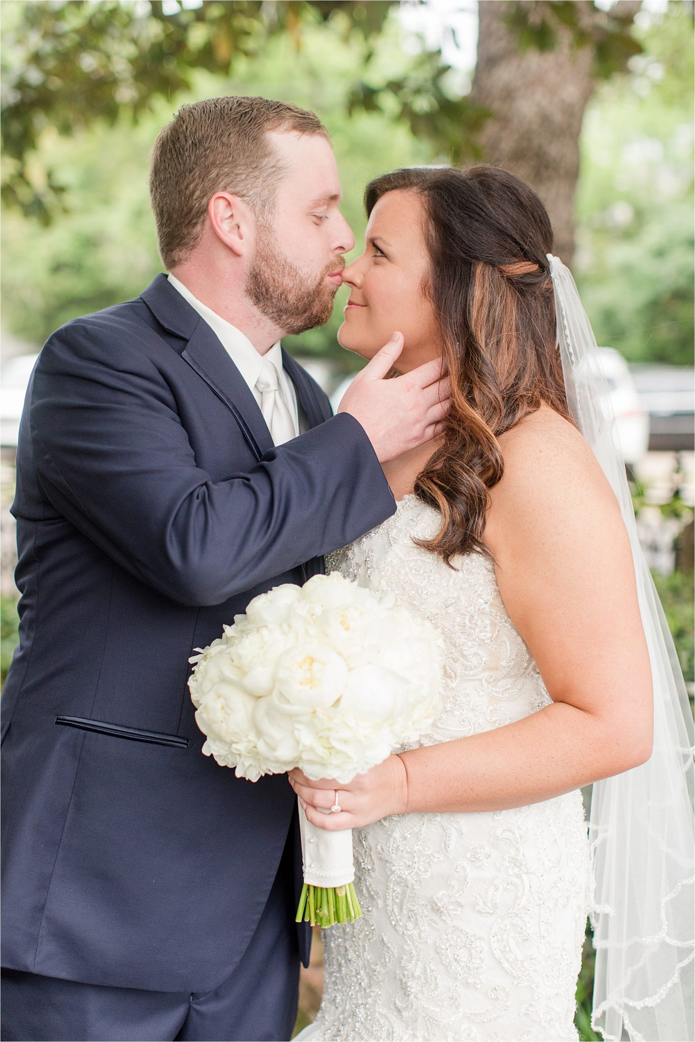 bride and groom photos-navy suit-white roses-wedding day photos-white tie-husband and wife photos-precious bride and groom photos-nose kisses