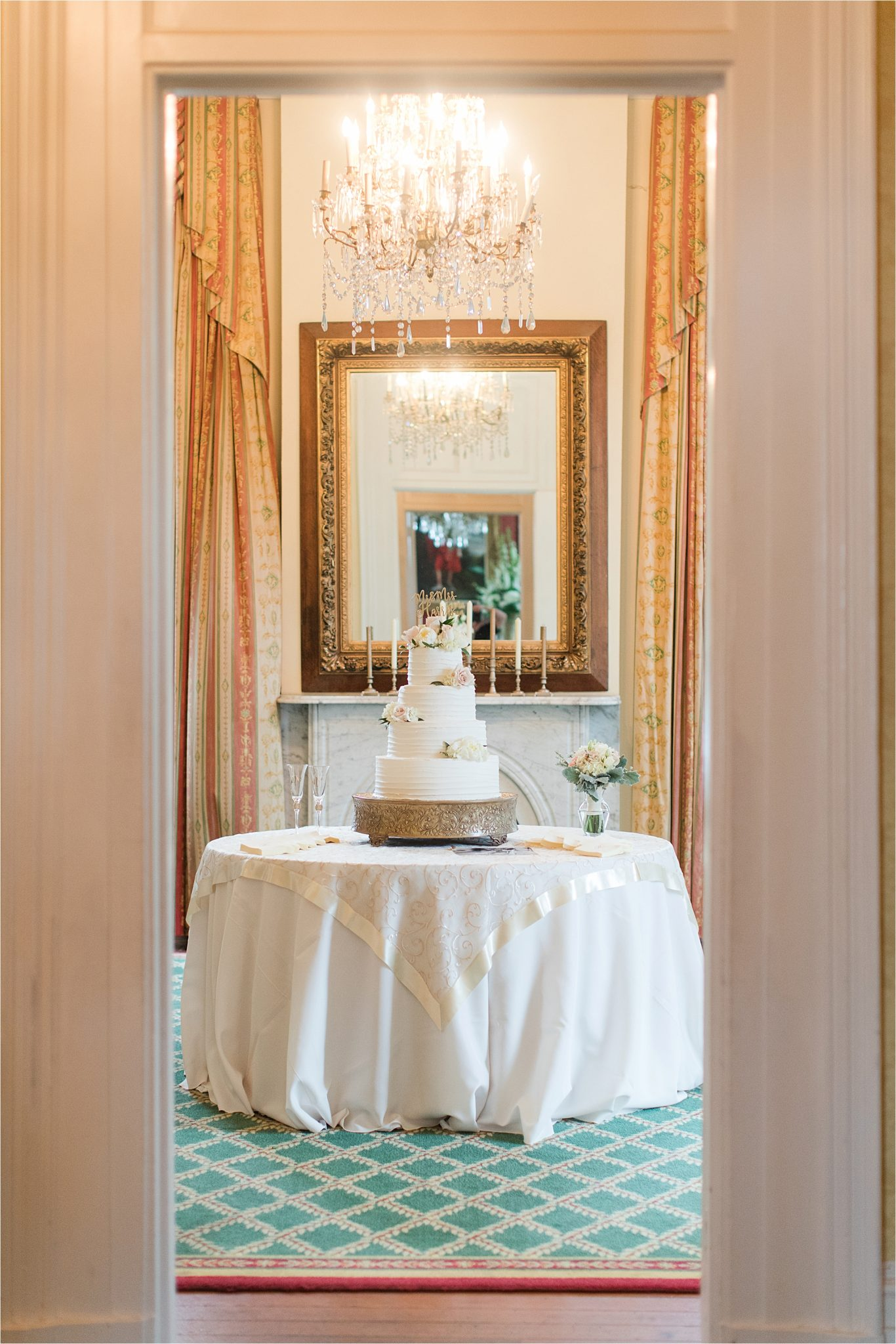 ezell house wedding reception-wedding cake- three tier-rustic cake stand-under of flowers-historic downtown mobile-alabama