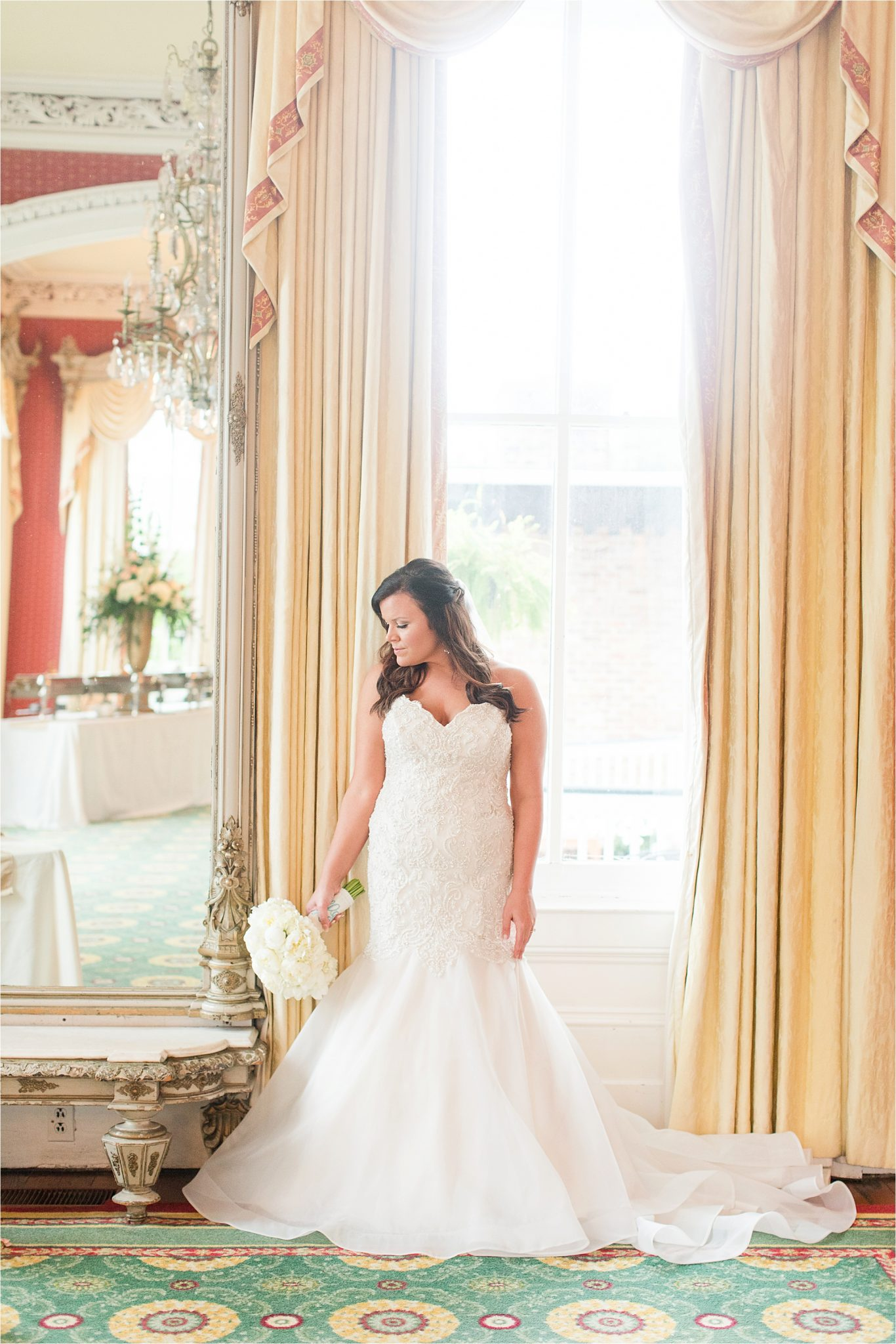stunning lighting-bridal portraits-mermaid wedding dress-ezell house historic downtown-alabama wedding photographer