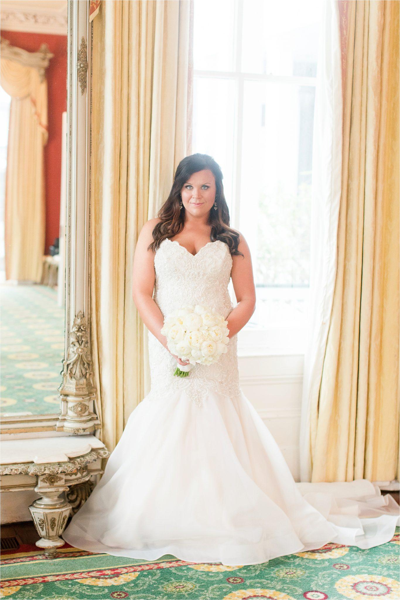 stunning lighting-bridal portraits-mermaid wedding dress-ezell house historic downtown-alabama wedding photographer