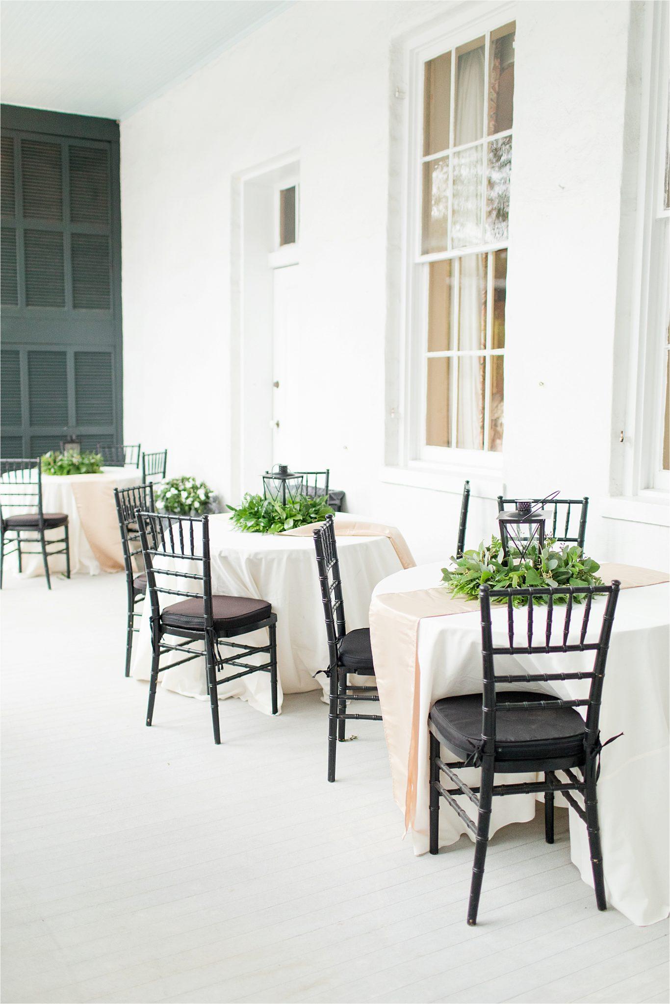 black wooden chairs-reception-lantern center pieces- neutrals-black tie event-round tables-neutral runner-wedding day-alabama wedding photographer