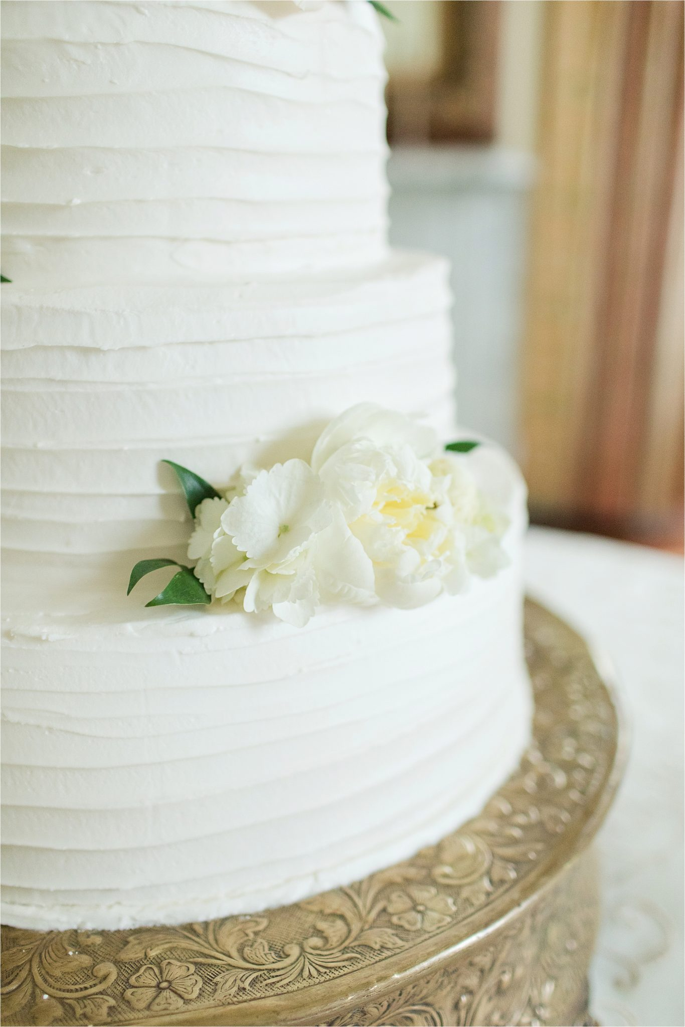 wedding cake-buttercream frosting-real flowers-ornate cake stand-rustic