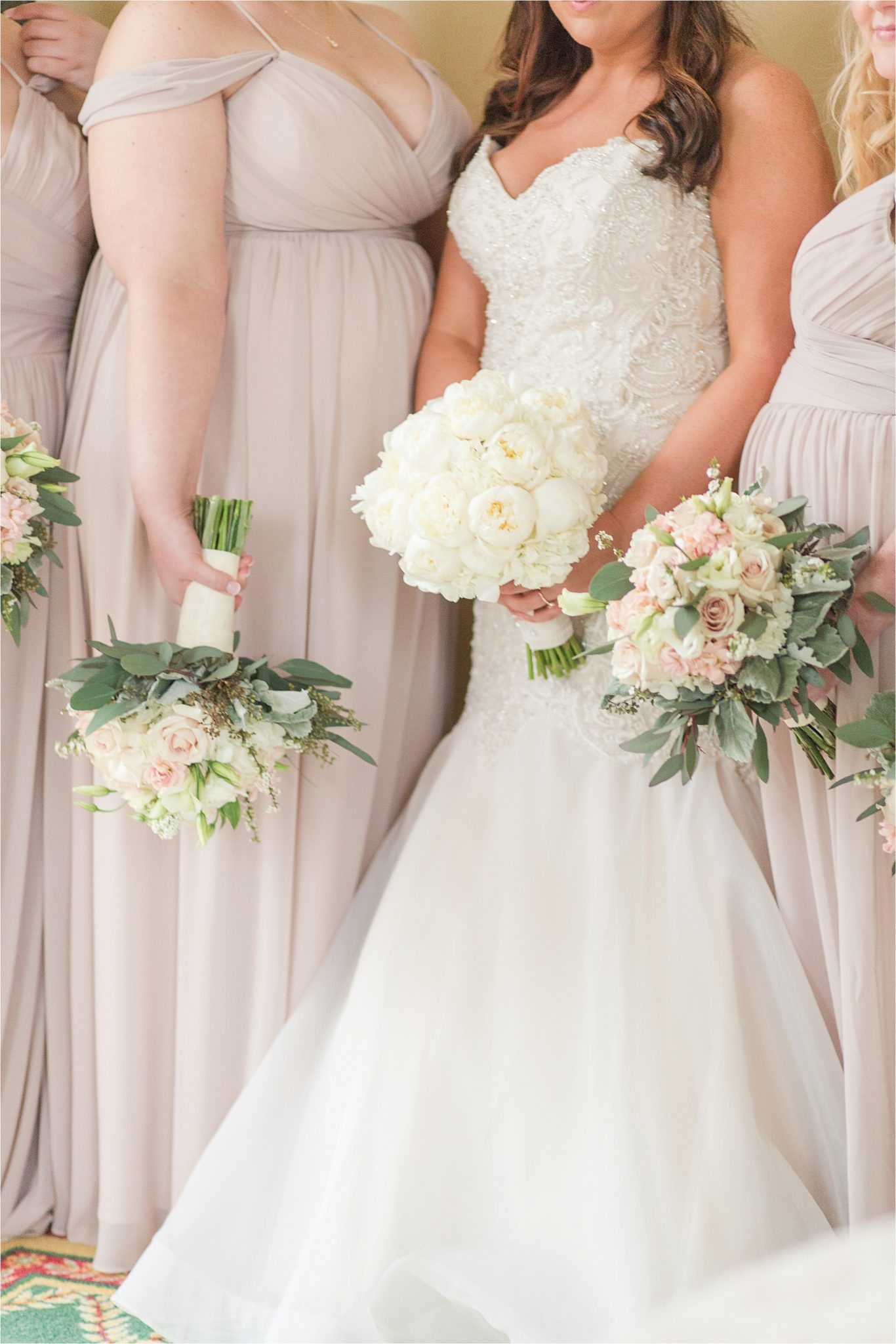 stunning lighting-bridal portraits-mermaid wedding dress-ezell house historic downtown-alabama wedding photographer-blush bridesmaid dresses-soft blushes-mermaid wedding dress-strapless bridal dress