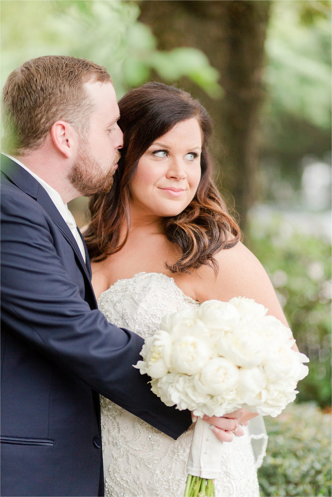 white rose bouquet-bride and groom-groom with beard-bride and groom portraits
