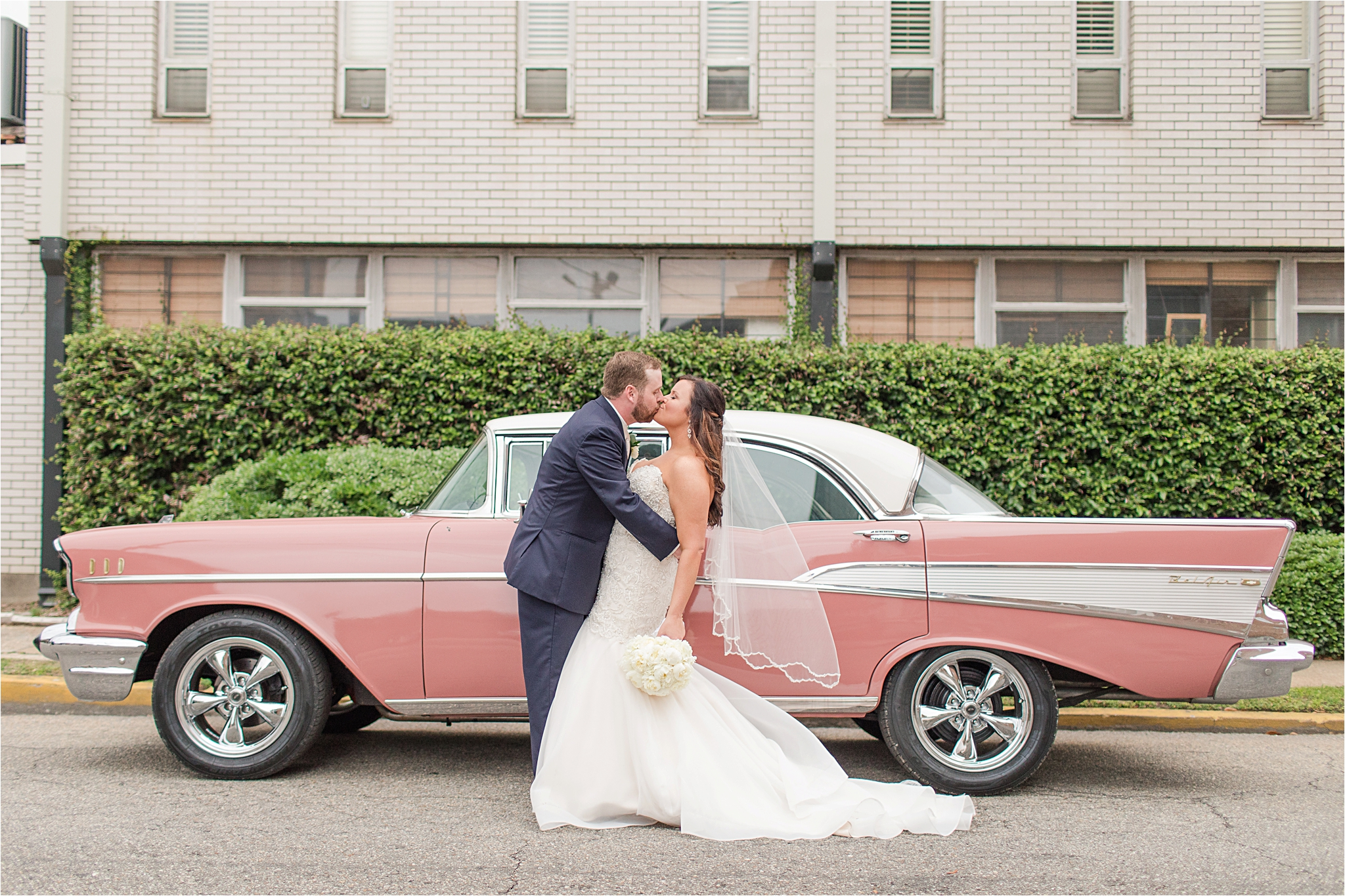 old fashion pink cadillac-just married-getaway car-mermaid cut dress-white rose bouquet-convertible cadillac-coral-pink-mauve-blush-terra cotta