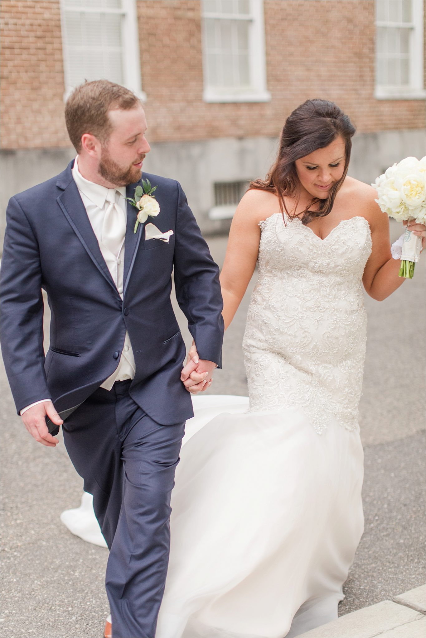 bride and groom photos-navy suit-white roses-wedding day photos-white tie-husband and wife photos-holding hands-navy suit-white tie