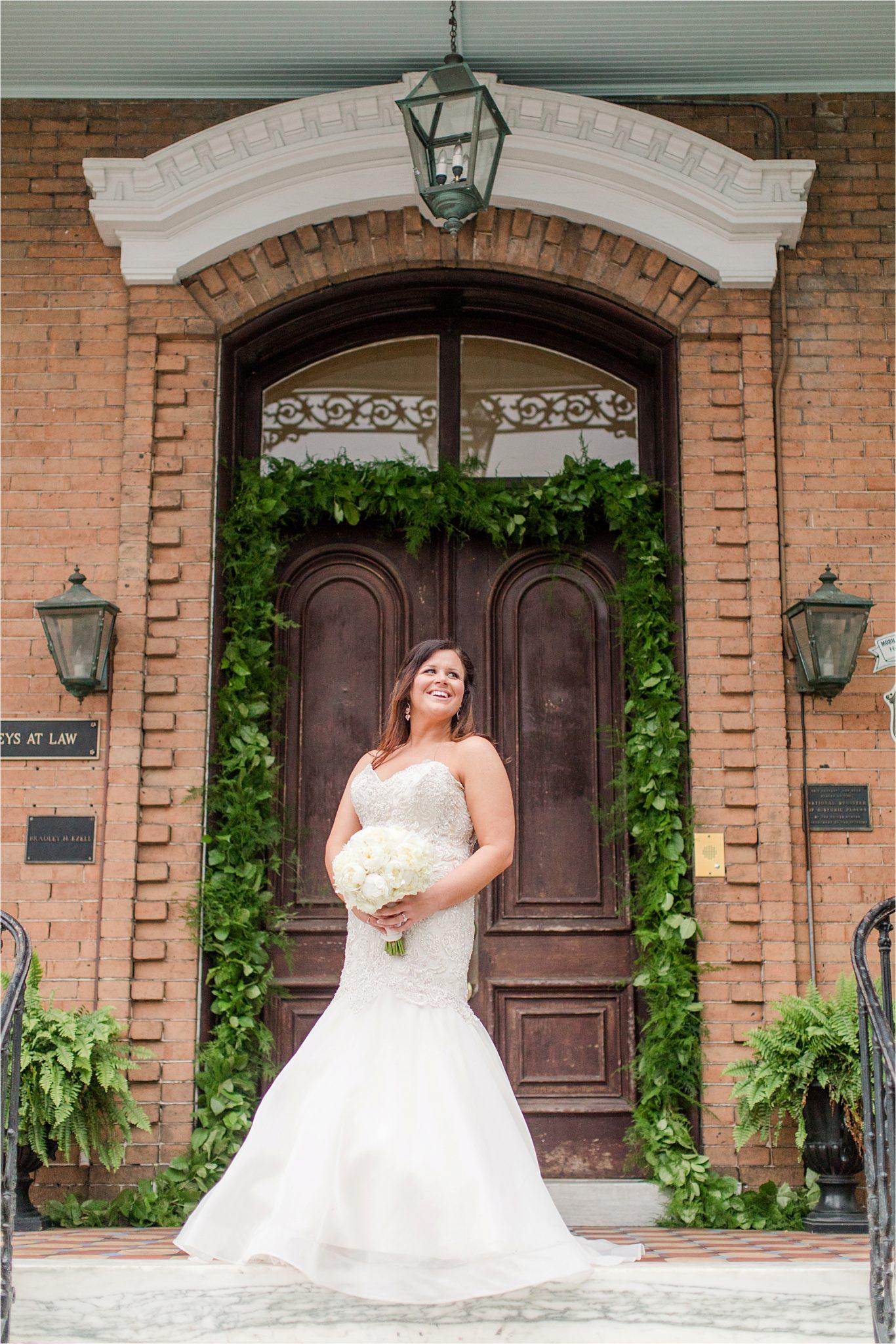 Mermaid wedding dress-bridal photos-brick background-ivy-frame