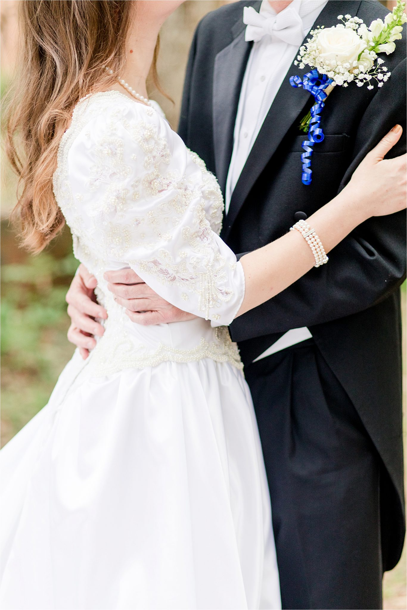 wedding dress with puffy sleeves-pearl beading-rose corsage-bride and groom