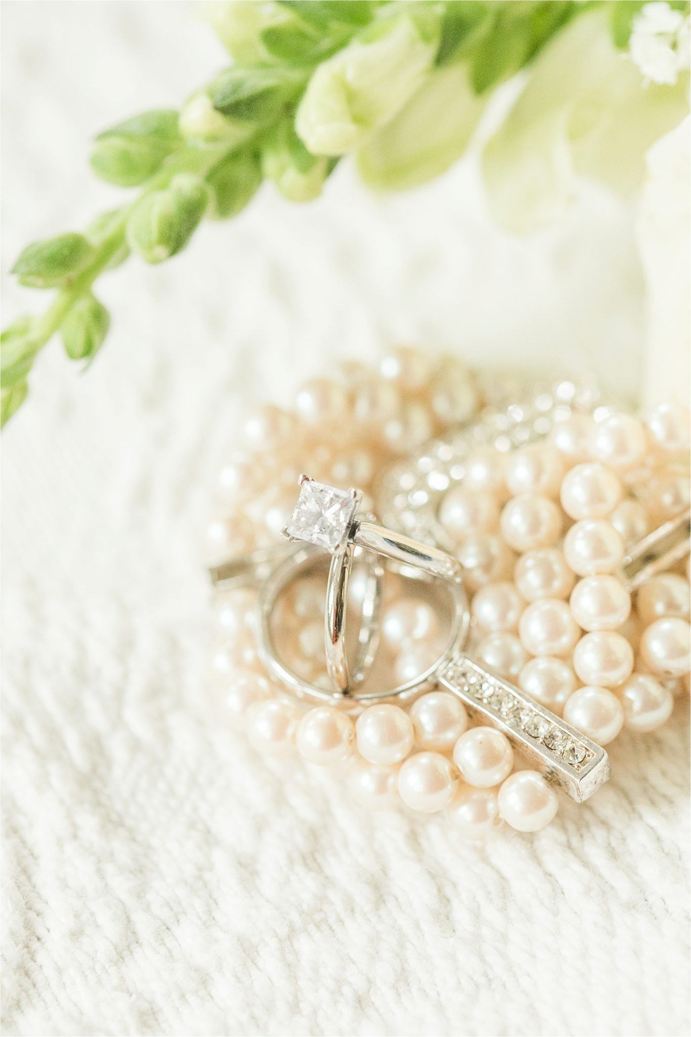 Princess cut wedding ring-white gold engagement ring-bride and groom ring shot-pearl wedding details-one carrot wedding rings
