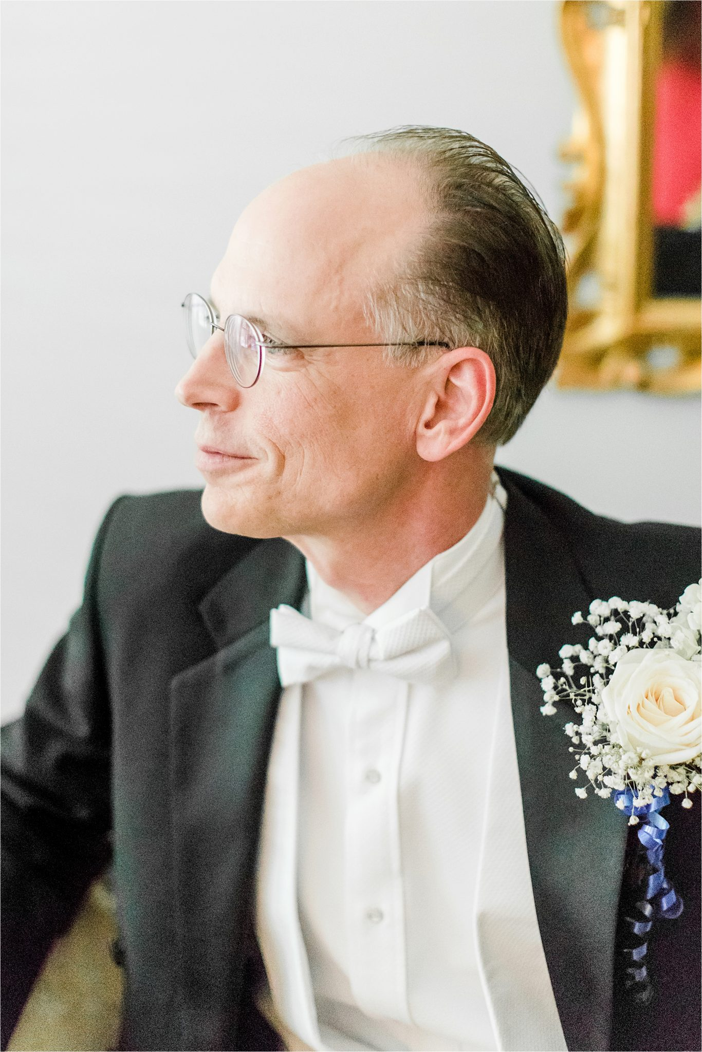 mature groom-groom with white bowtie- white rose corsage-groom corsage