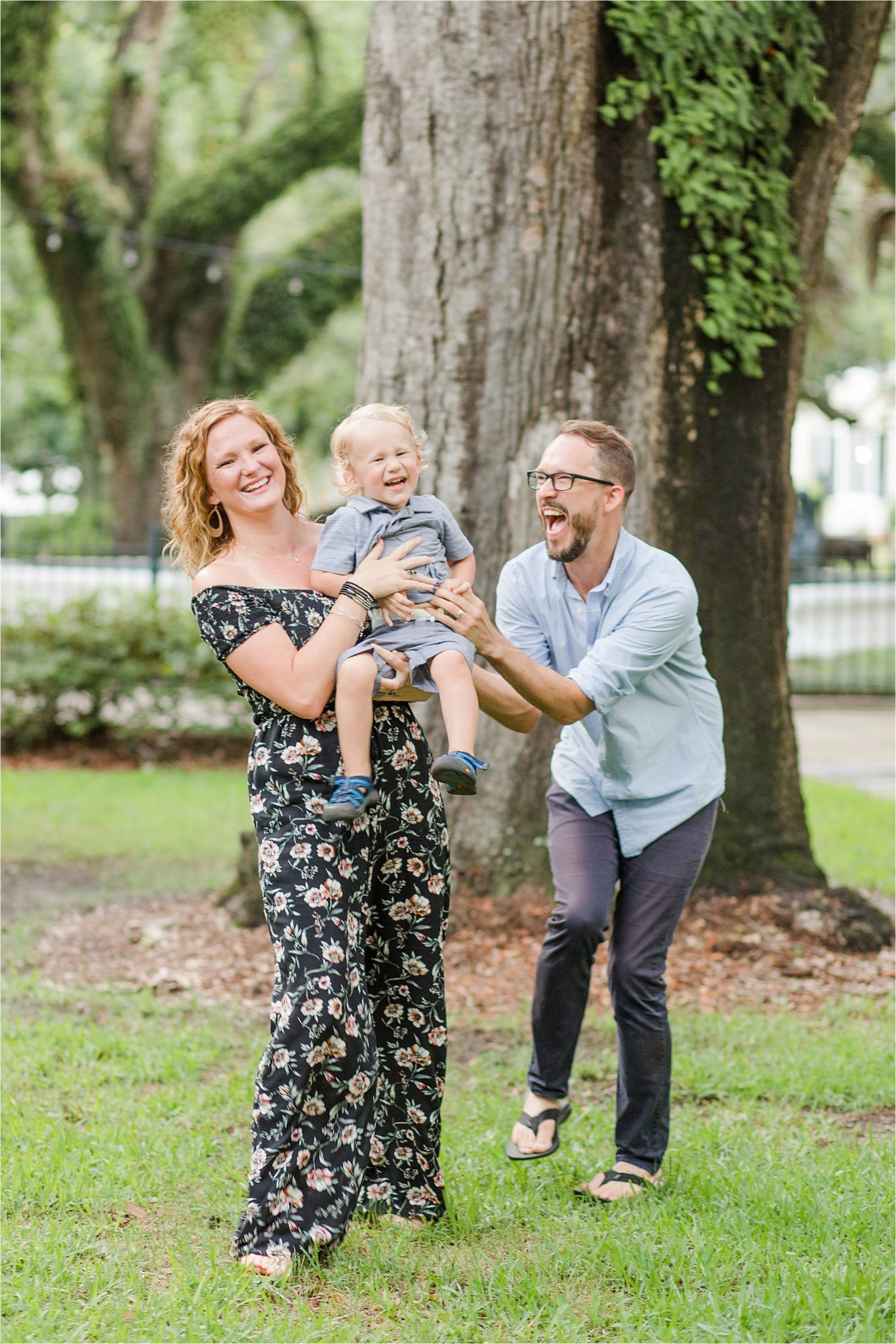 joyful family photos-Alabama Family Photography-mother father and son photos-family of three-candid family photography