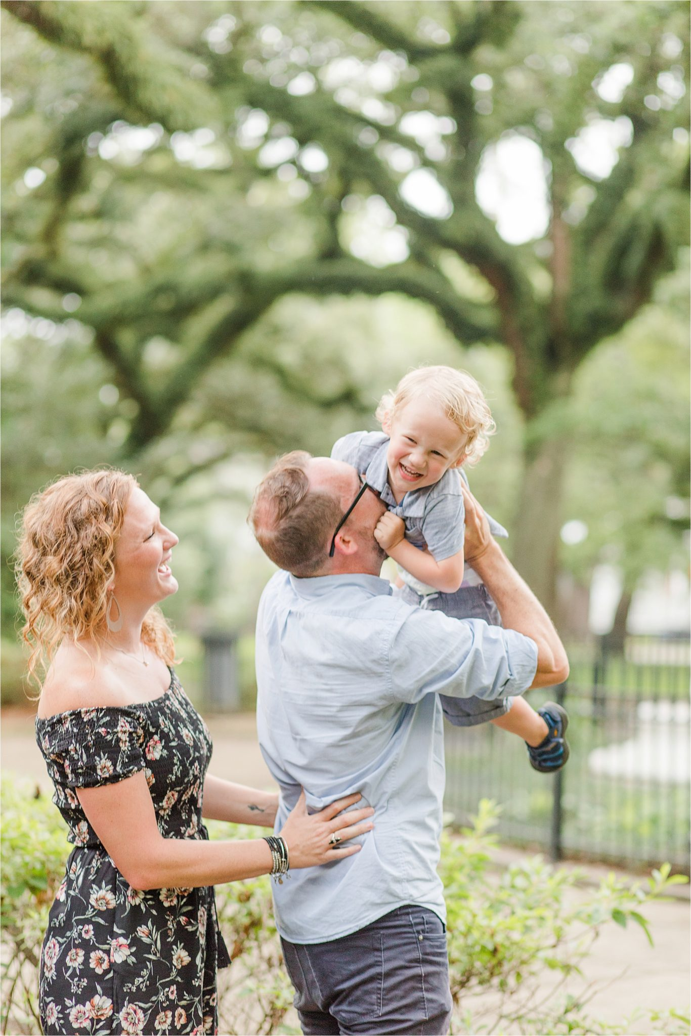 joyful family photos-Alabama Family Photography-mother father and son photos-family of three-candid family photography