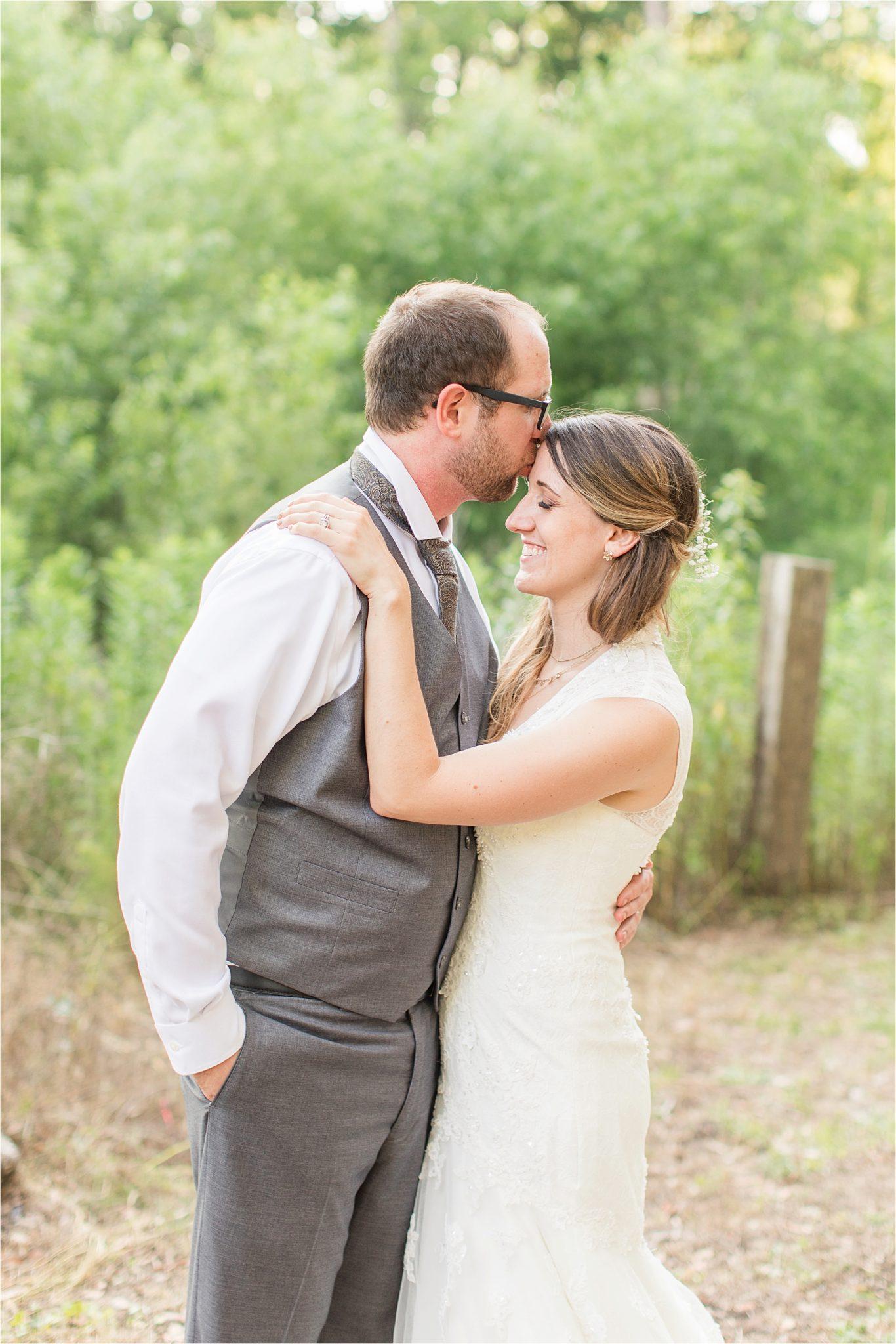 Precious bride and groom shots-photos-grey groomsmen suit-vest-bride and groom