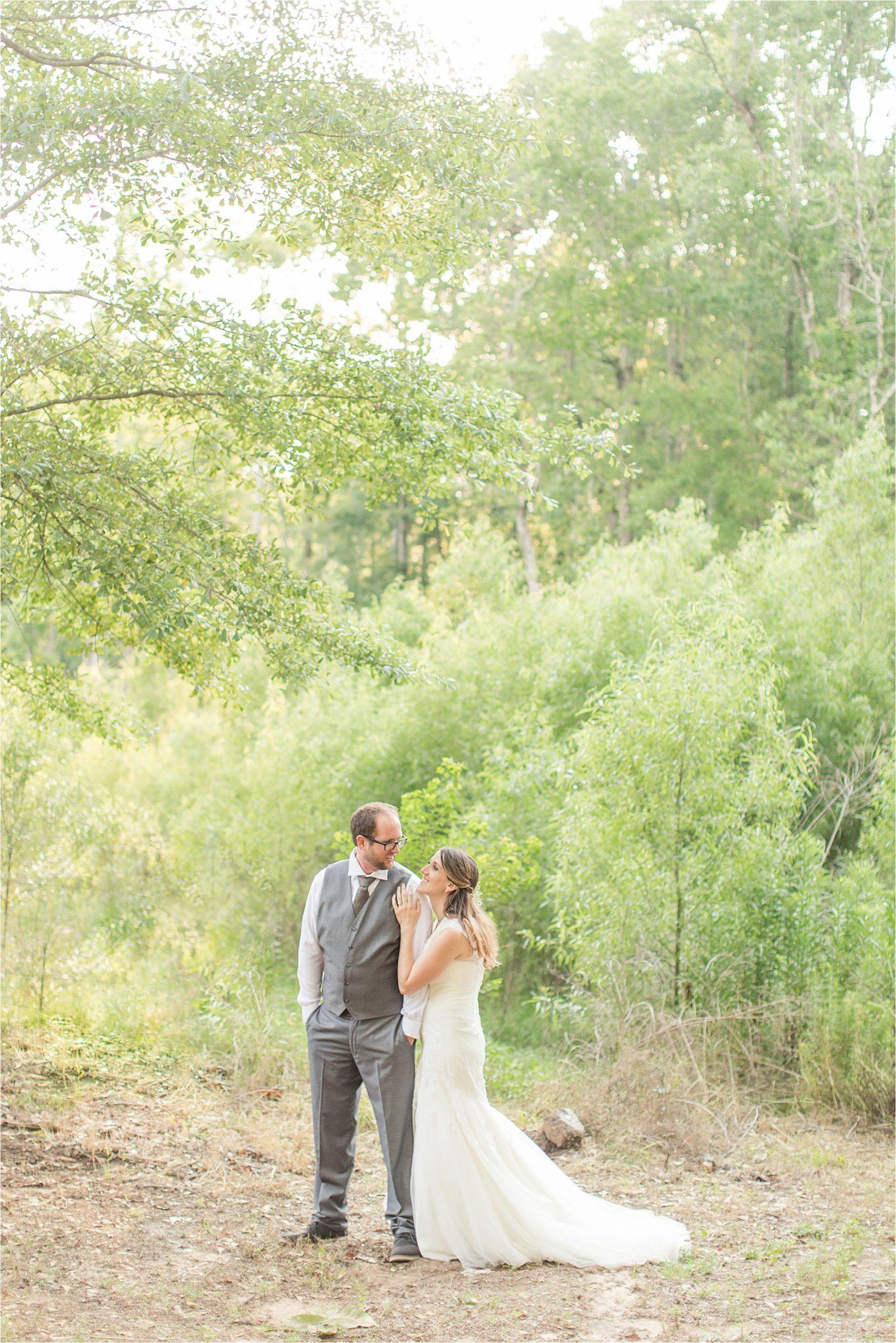 photos of the bride and groom-grey suit-groom in vest-backyard country wedding
