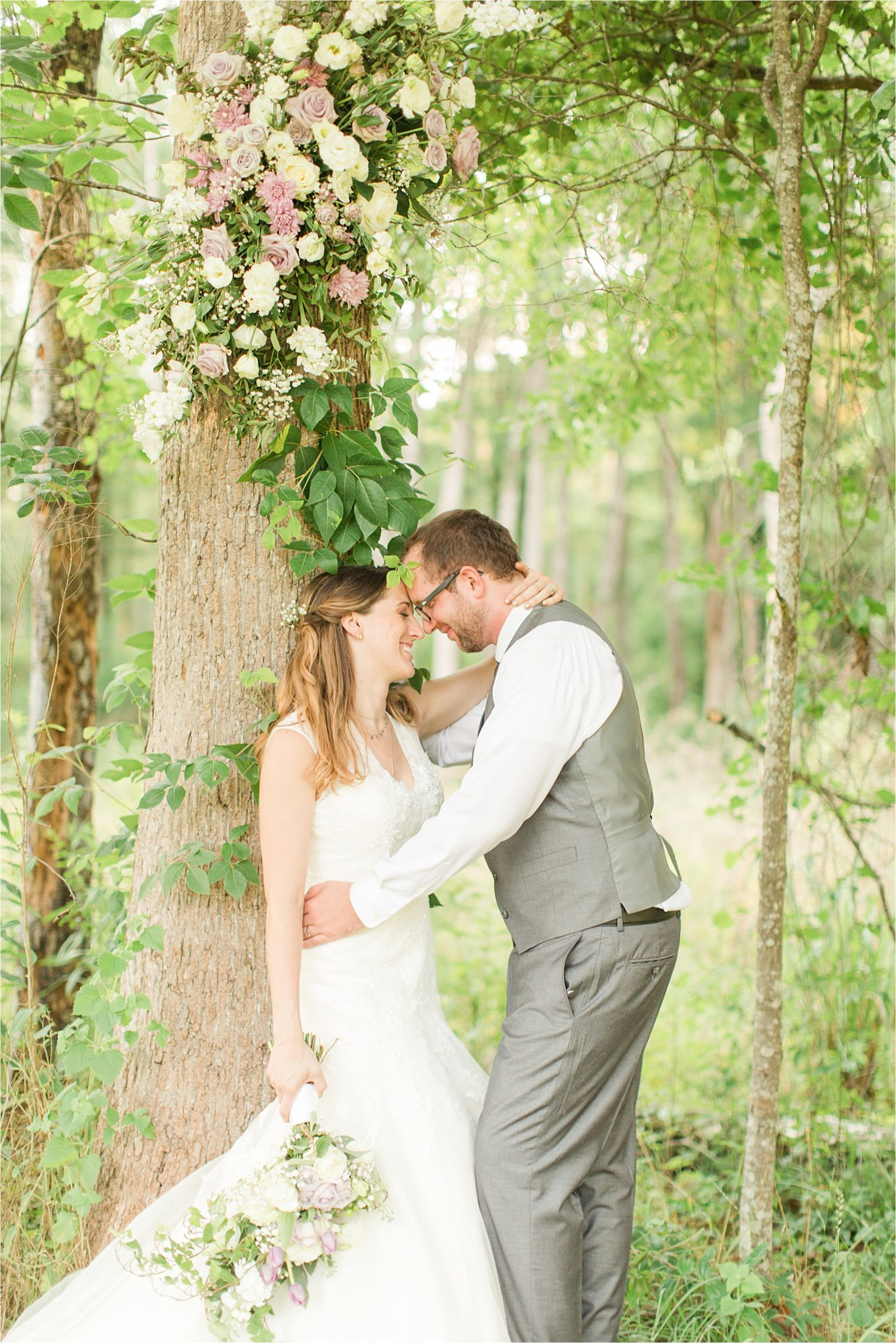 decorate trees with wedding flowers-bride and groom portraits-wedding day-grey grooms suit-vest-lavender flowers