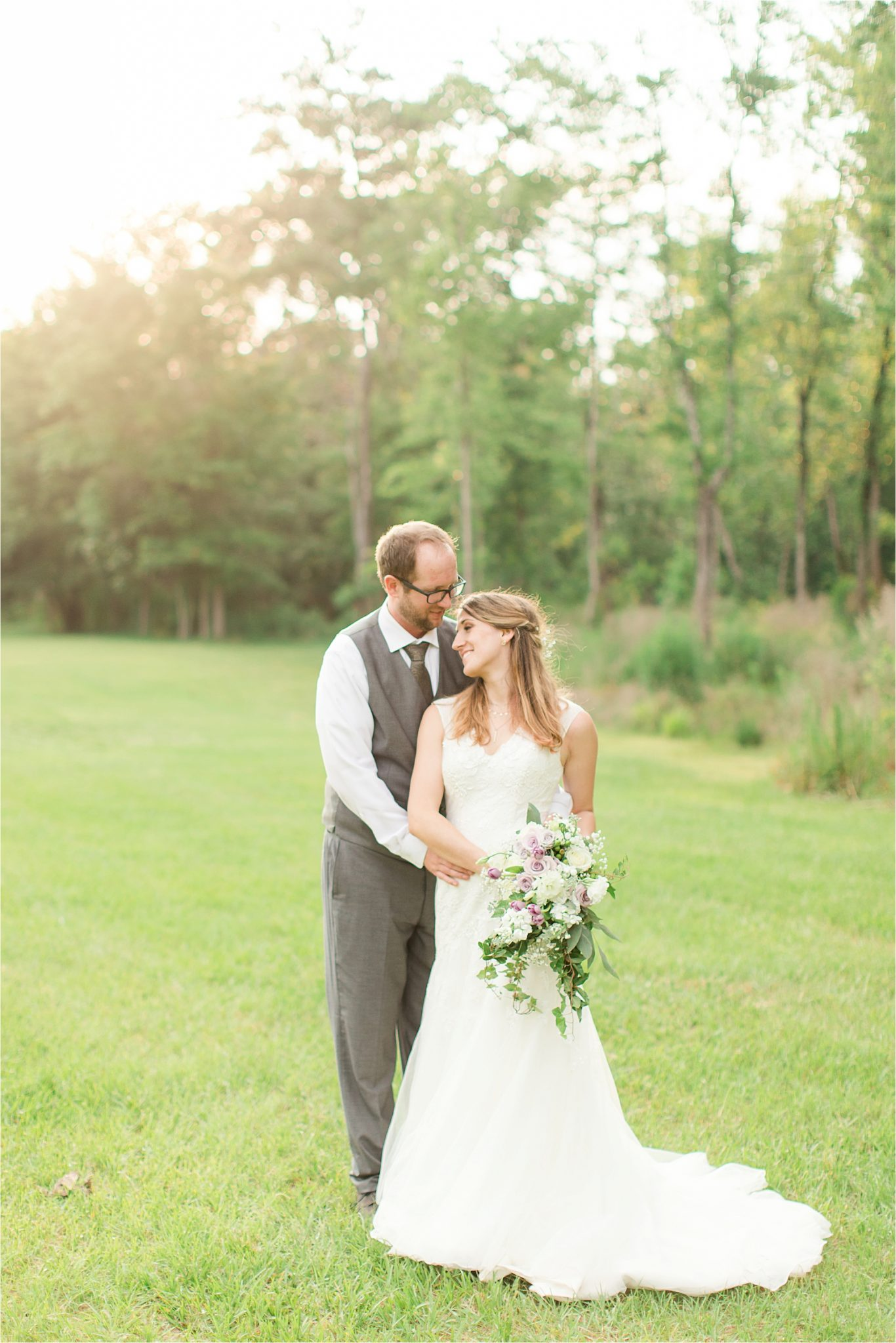 photos of the bride and groom-grey suit-groom in vest-lavender bouquet-backyard country wedding