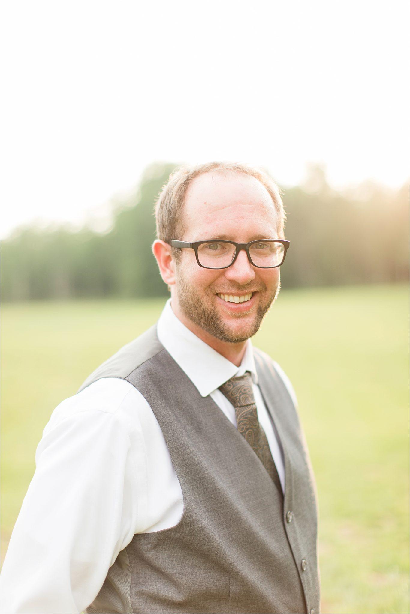 paisley tie-backyard country wedding-groom portraits-grey vest-white dress shirt