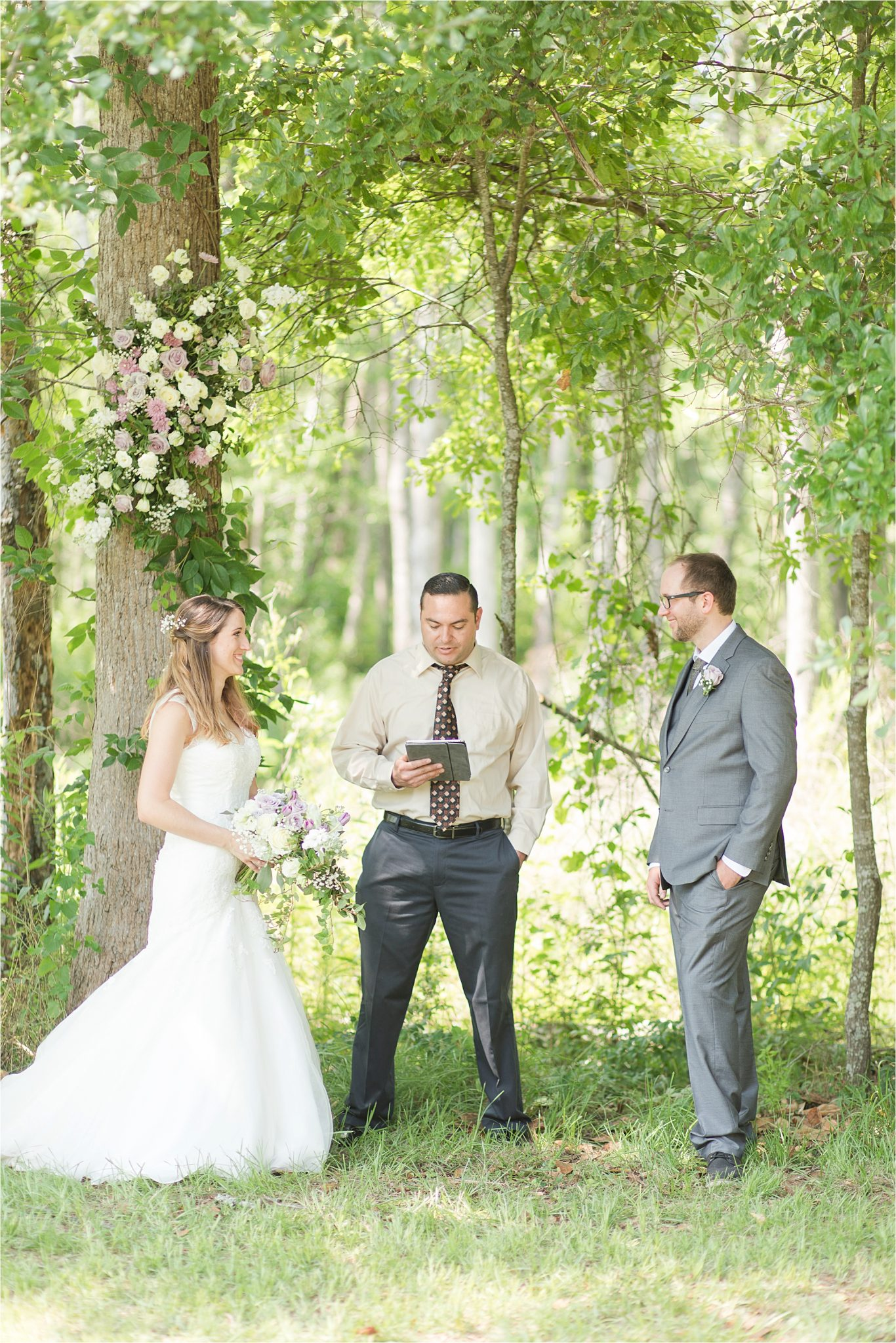 Backyard Wedding in the Country-decorate trees with flowers-woods as wedding backdrop-ceremony in front of forest-woods frame bride and groom ceremony