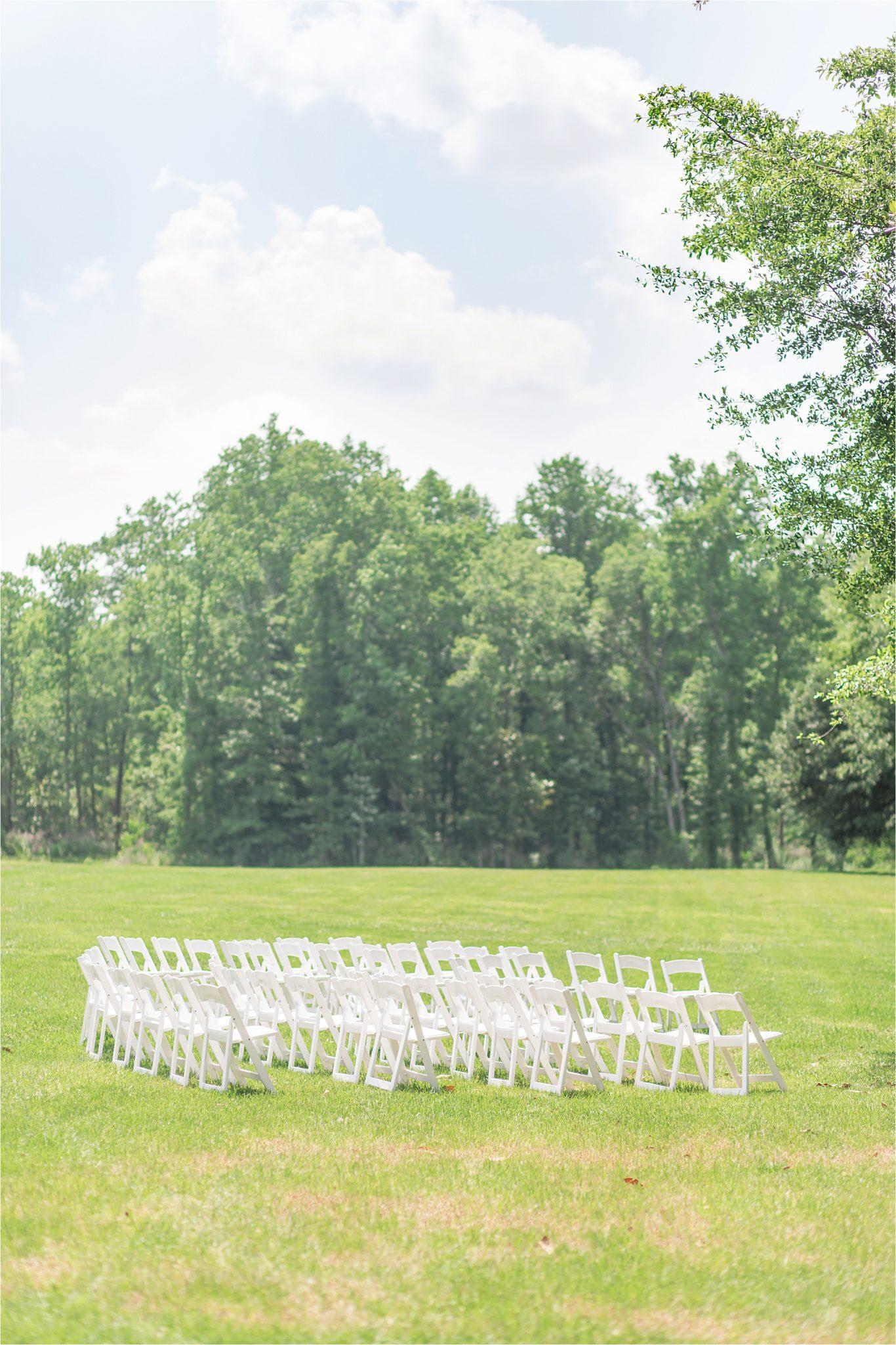 backyard-country-wedding-budget-white chairs-wedding chairs-open feild