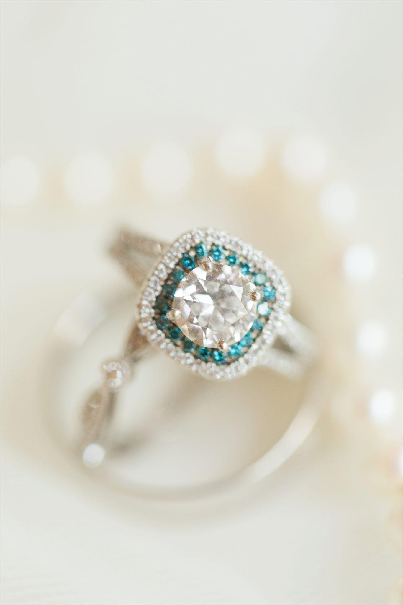 white gold-blue diamond-cushion cut-engagement ring-double halo-halo-double band-diamonds
