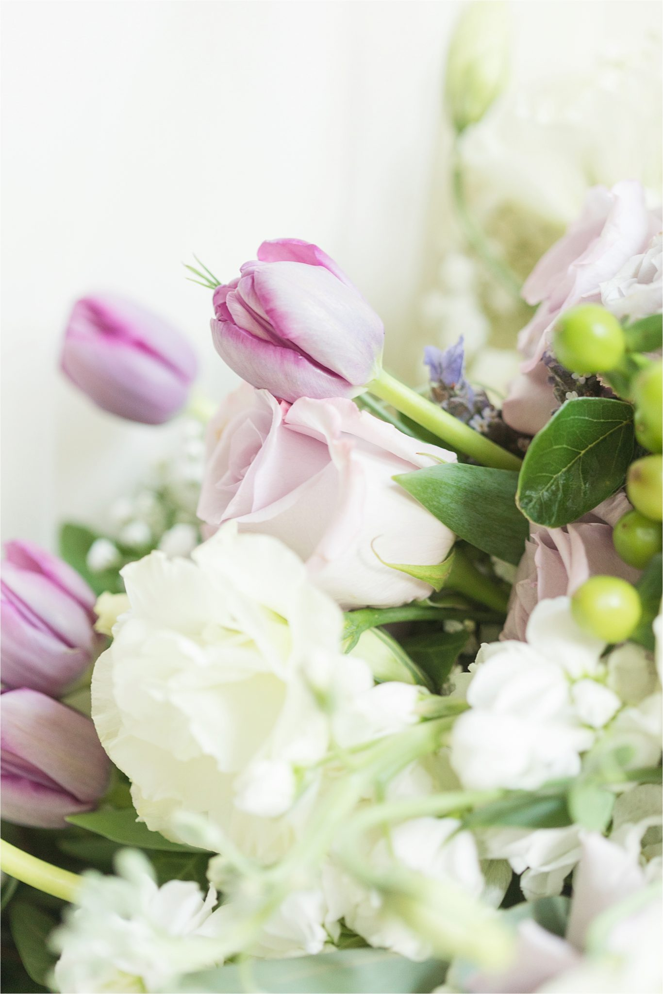 purple and pink-tulips-wedding bouquet-white flowers-roses-greenery-hypericum berries