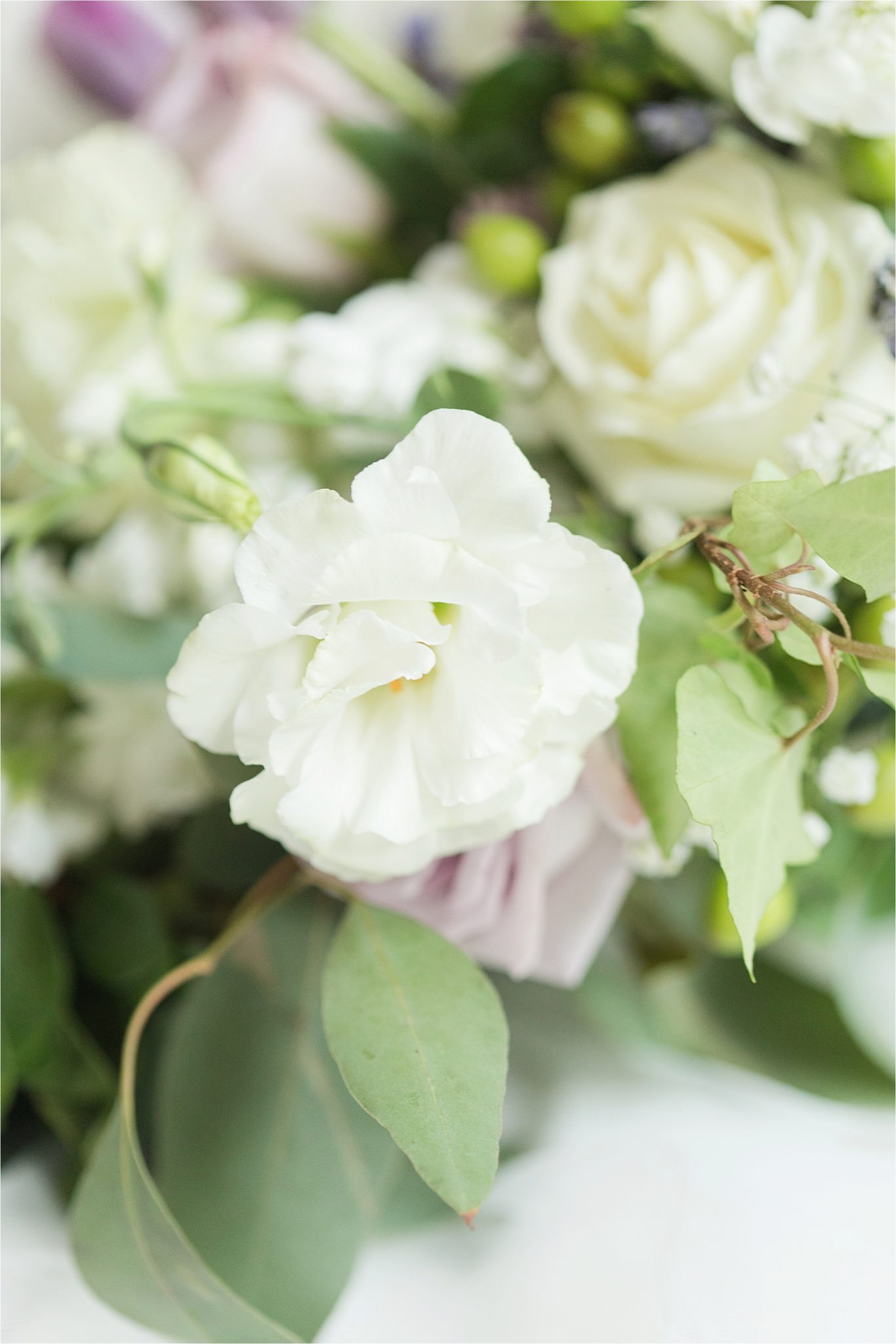 lavender-white roses-flowers-greenery-white wedding bouquet