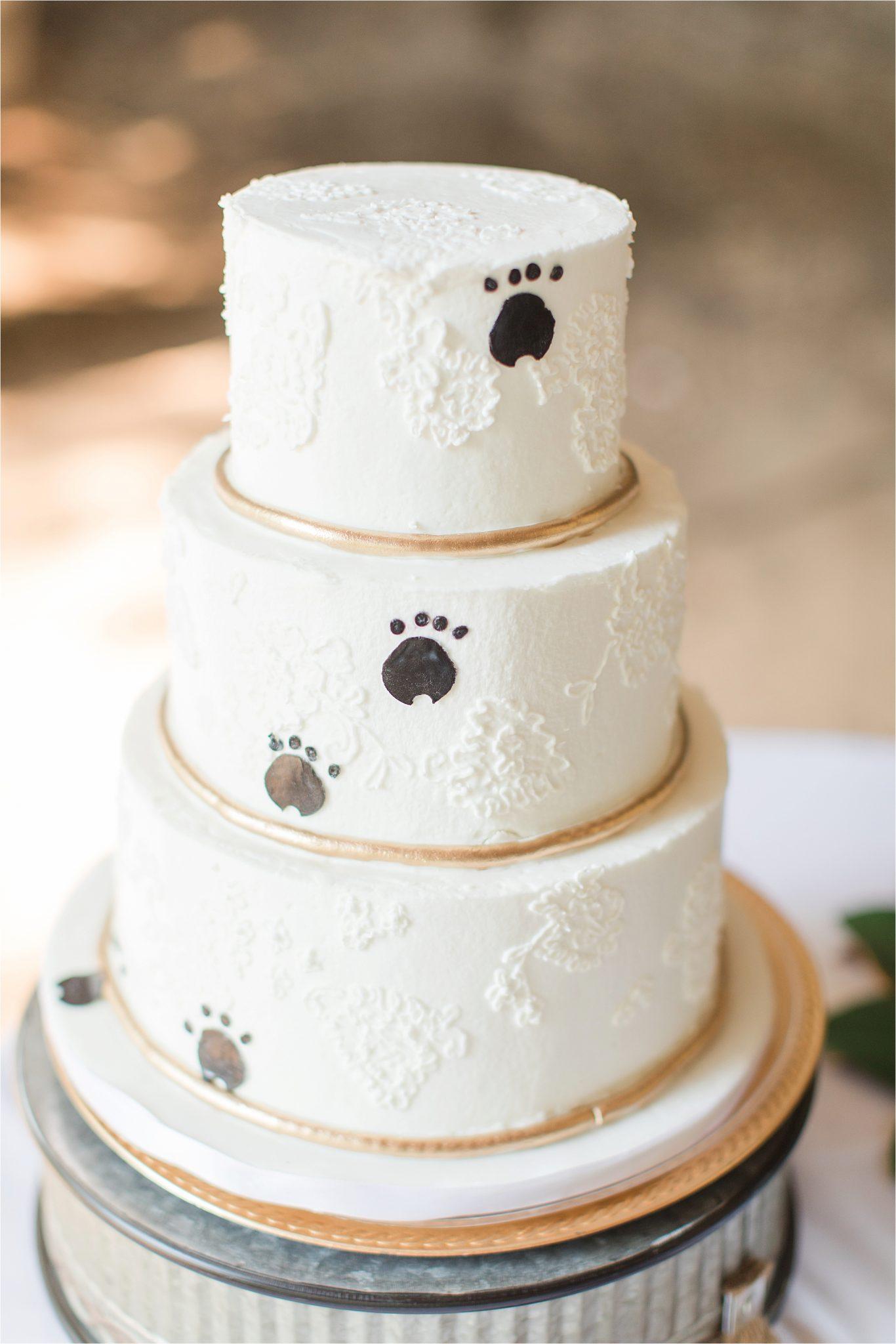 wedding cake-paw prints-dog cake-three tier wedding cake-gold accents