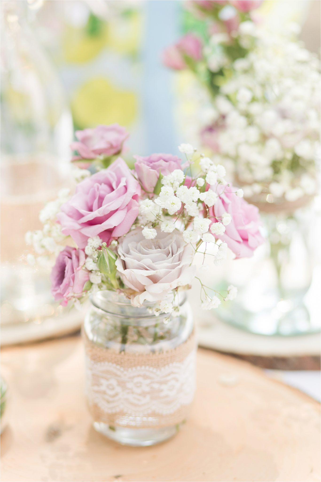 pink and purple rose center pieces-mason jars-lace-babies breath