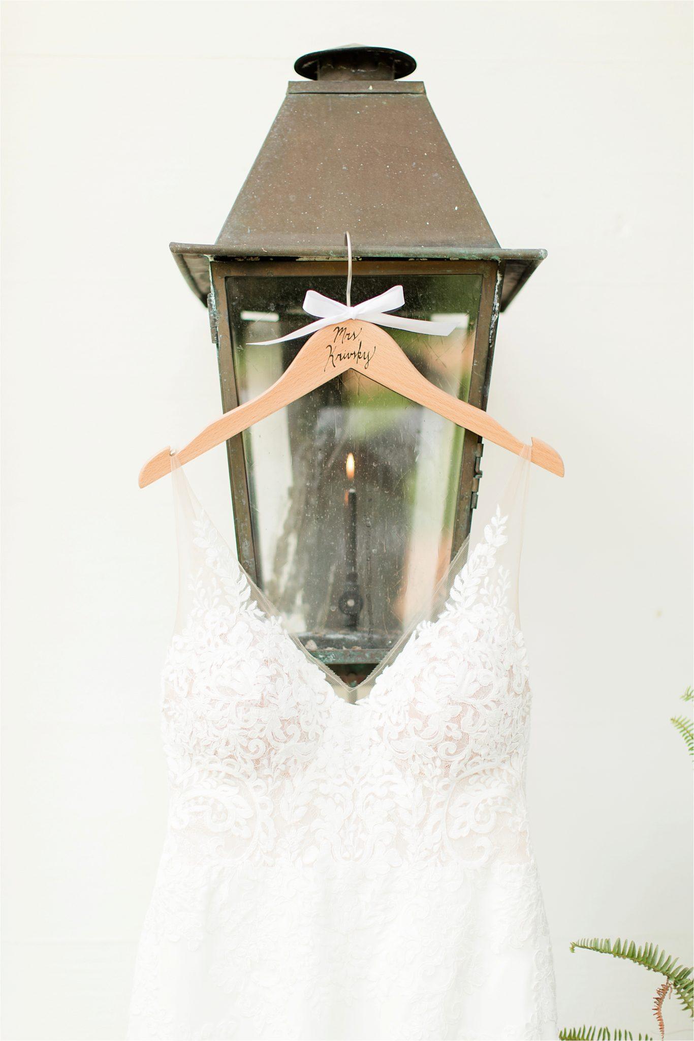 Hedge Farm Wedding-Alabama Wedding Photographer-Barn Wedding-Wedding Dress-lamp post-wedding hanger with Mrs.