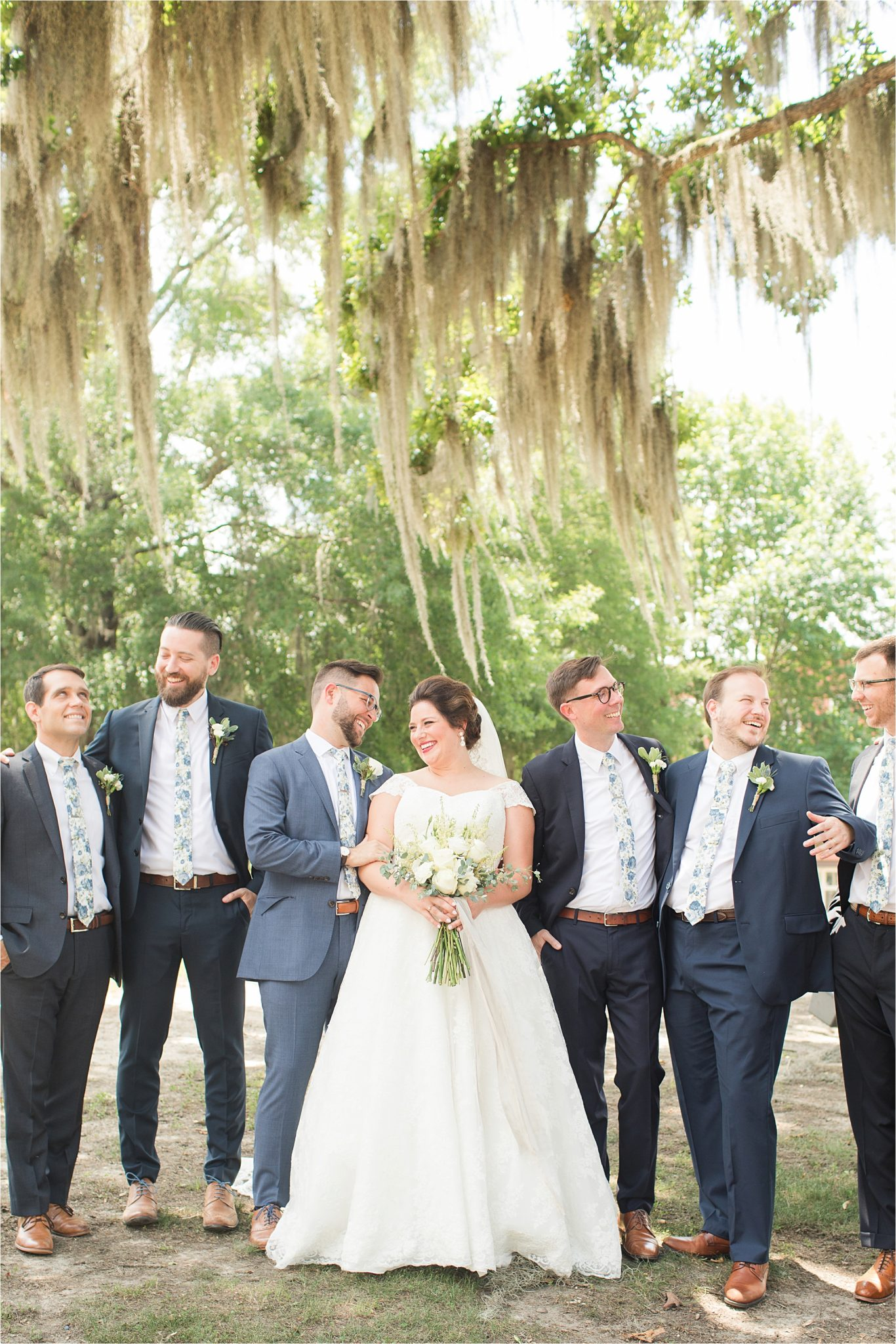 Pastel Themed Wedding-The Chapel at the Waters-Montgomery Alabama Photographer-Miles & Meredyth-Blue Themed Wedding-Navy Blue Groomsmen-Bride and groomsmen-Wedding Dress