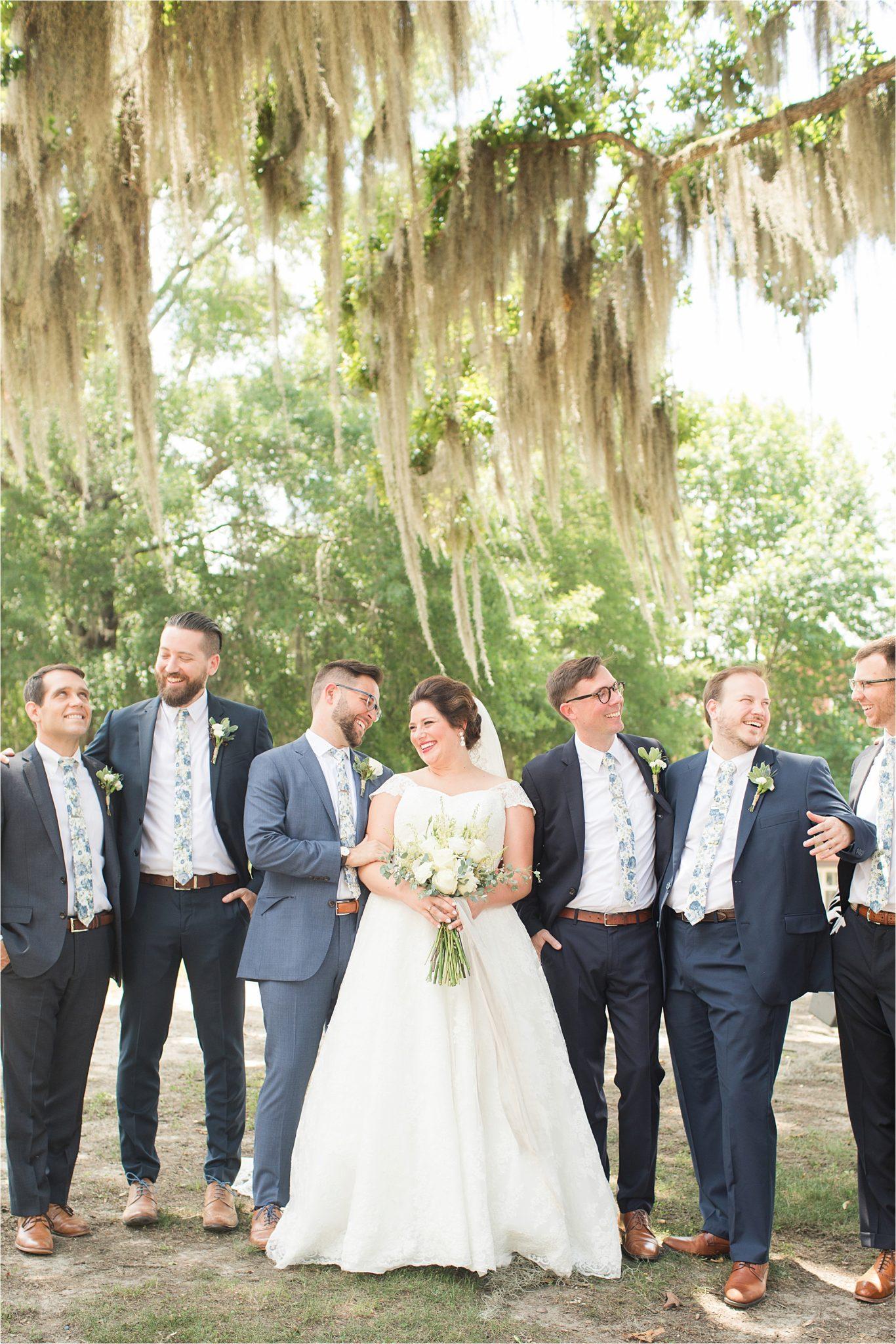 Pastel Themed Wedding-The Chapel at the Waters-Montgomery Alabama Photographer-Miles & Meredyth-Blue Themed Wedding-Navy Blue Groomsmen-Bride and groomsmen-Wedding Dress