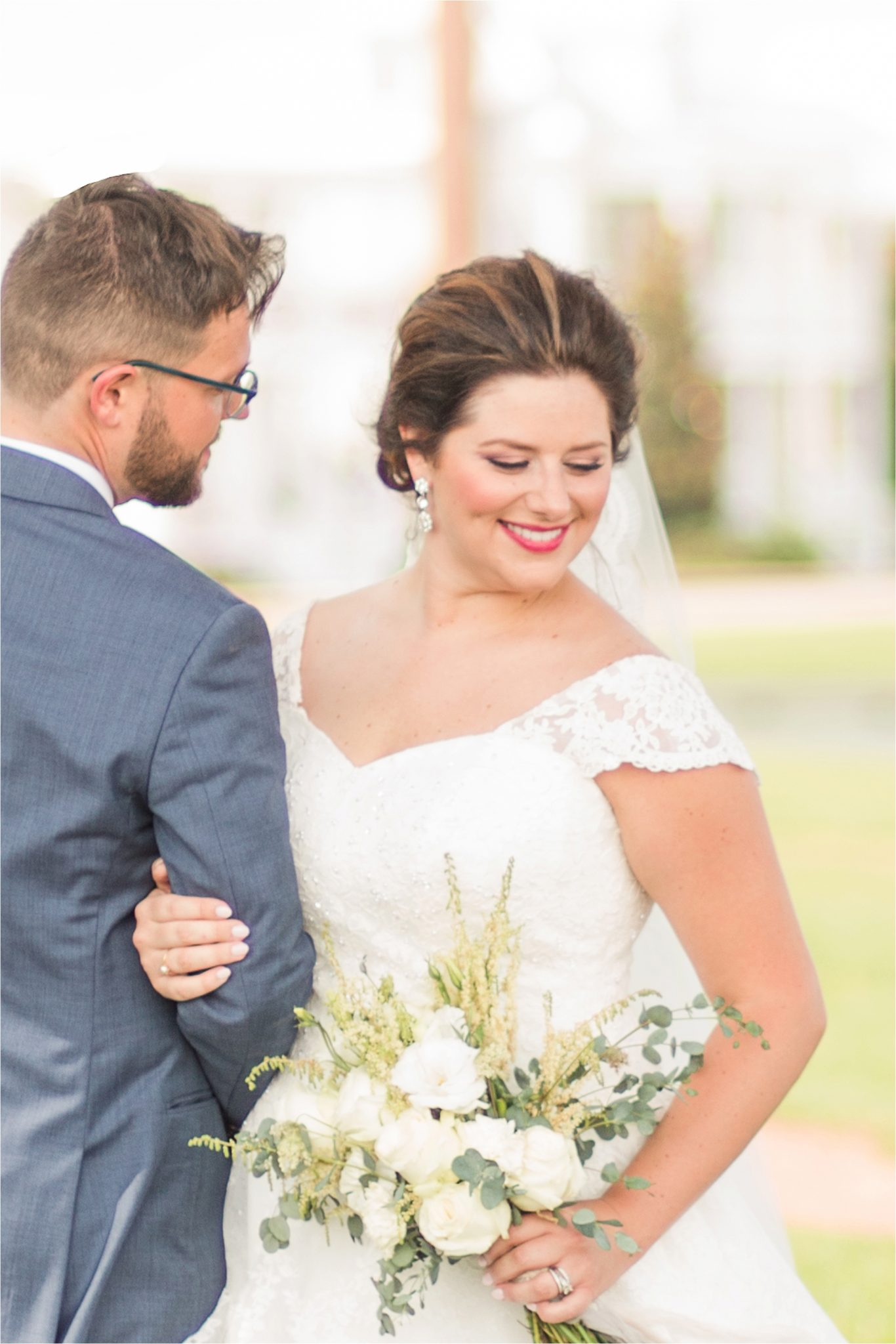 Pastel Themed Wedding-The Chapel at the Waters-Montgomery Alabama Photographer-Miles & Meredyth-Blue Themed Wedding-Navy Blue Groom Attire-Wedding Dress-Bride Bouquet
