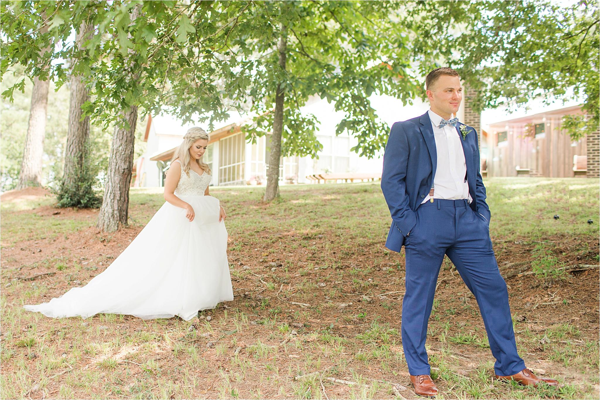 blue-suit-groom-bride-bow-tie-first-look